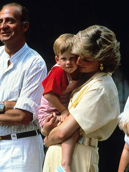 Princess Diana hugs baby Prince Harry on holiday in Majorca, Spain on August 10, 1987.