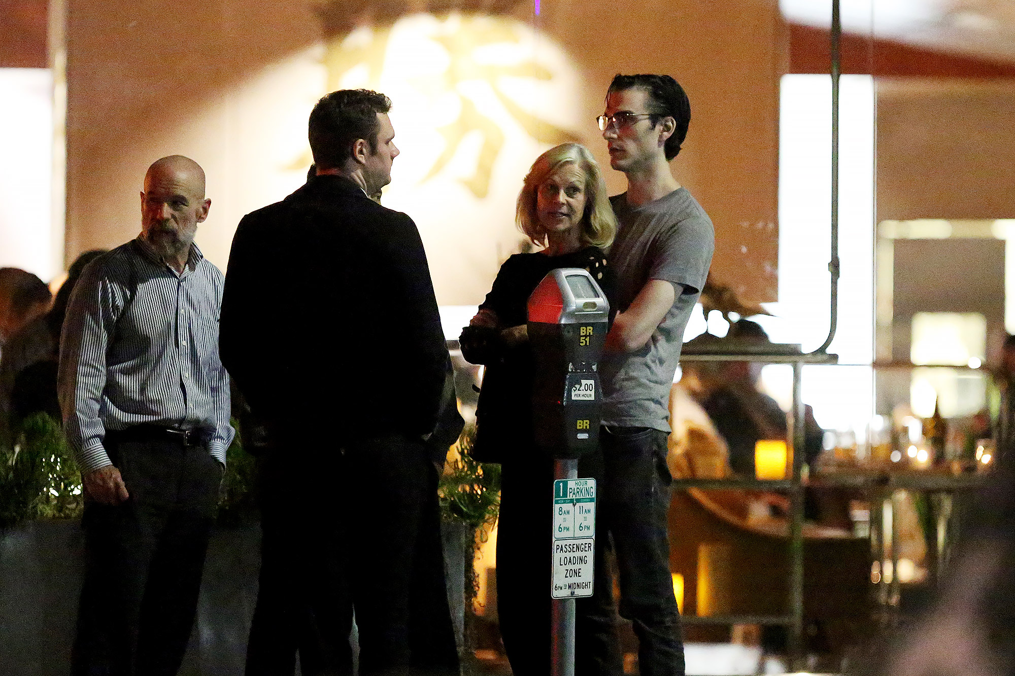 Cooper Hefner looks somber and stands alone after meal with family in Brentwood, CA.