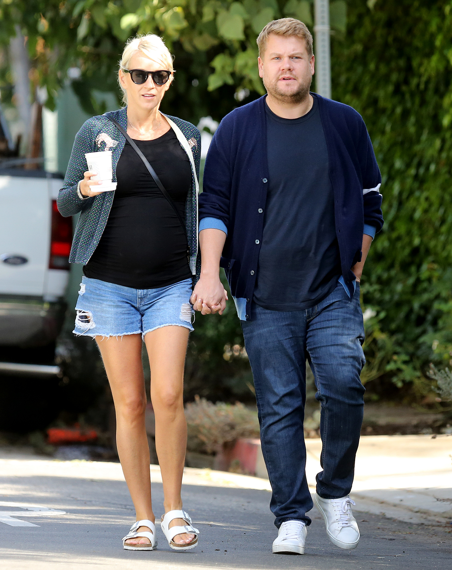 EXCLUSIVE: James Corden smiles with his pregnant wife in LA.