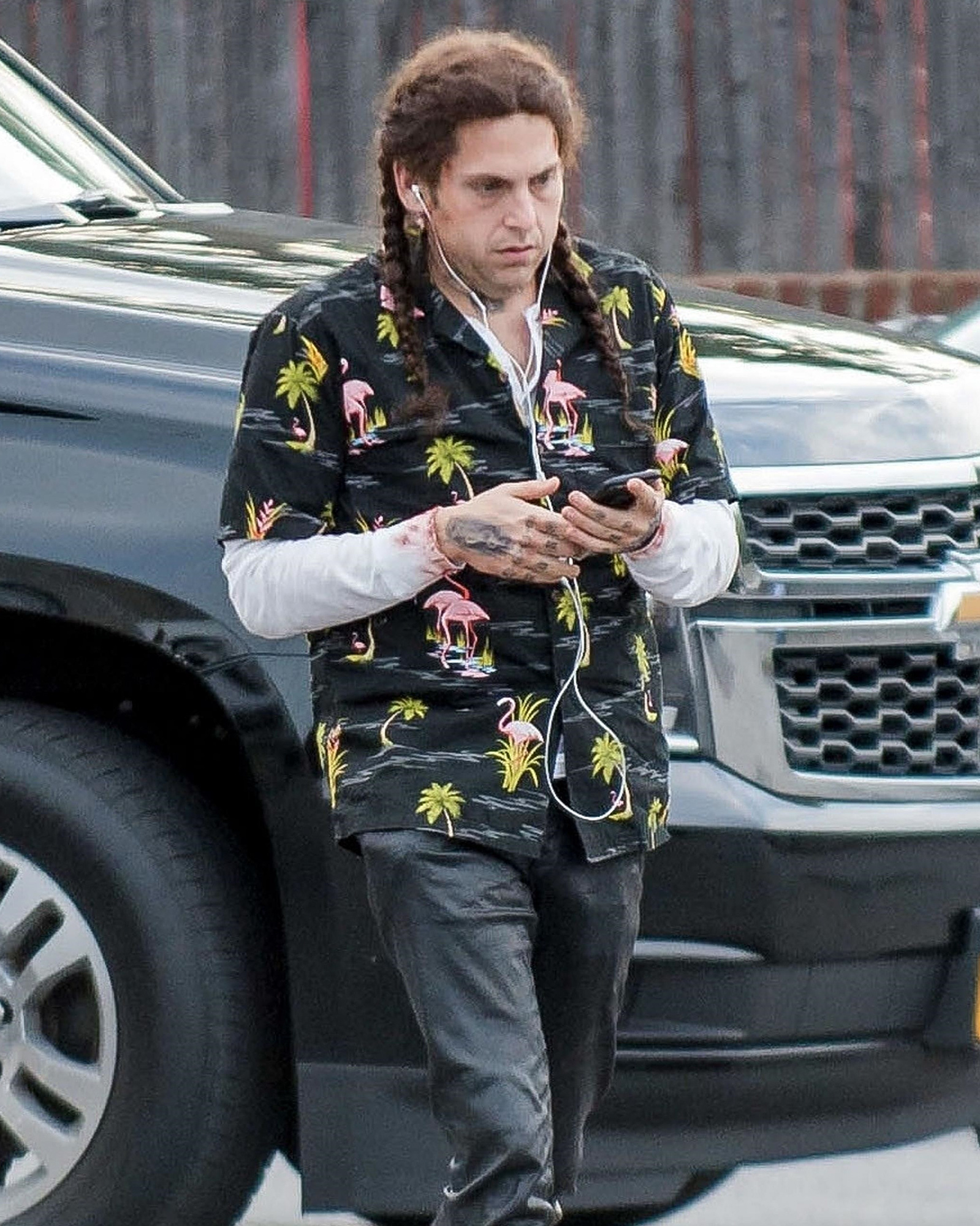 *EXCLUSIVE* Jonah Hill rocks braids and tattoos on the set of 'Maniac'