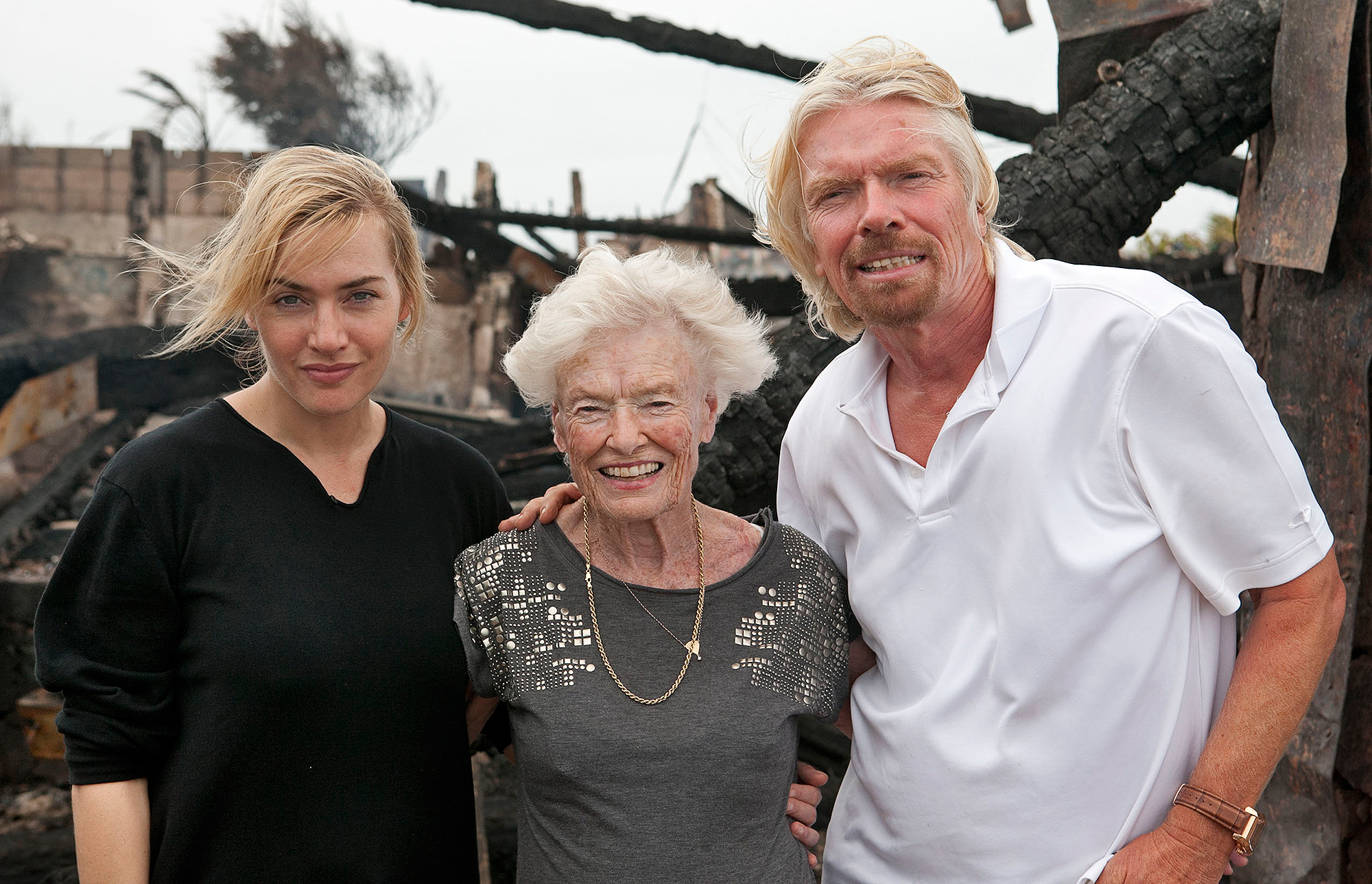 EXCLUSIVE: Film star Kate Winslet wraps her arm around Sir Richard Branson's mother Eve, who she saved from his blazing home on Necker Island
