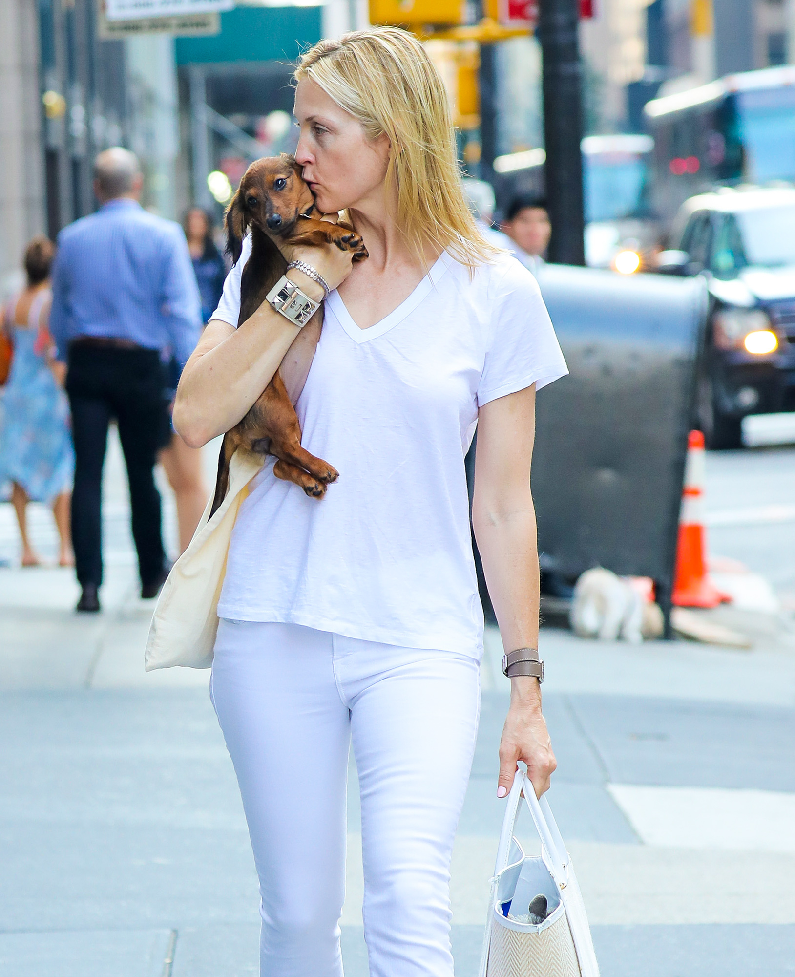 Kelly Rutherford is spotted carrying her puppy while strolling on Madison Avenue in New York City