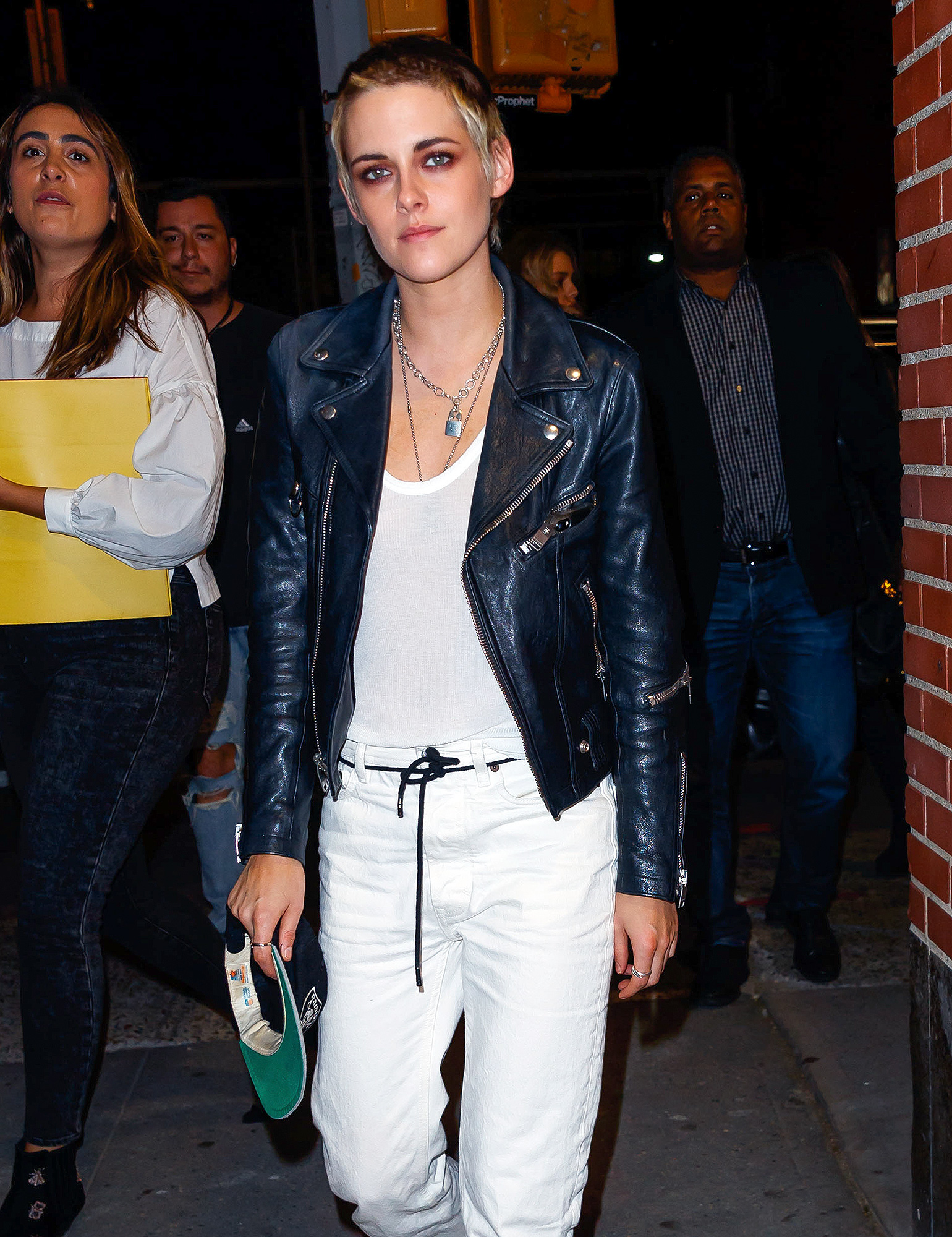 EXCLUSIVE: Kristen Stewart poses for photos on a street corner in New York with girlfriend Stella Maxwell in the background