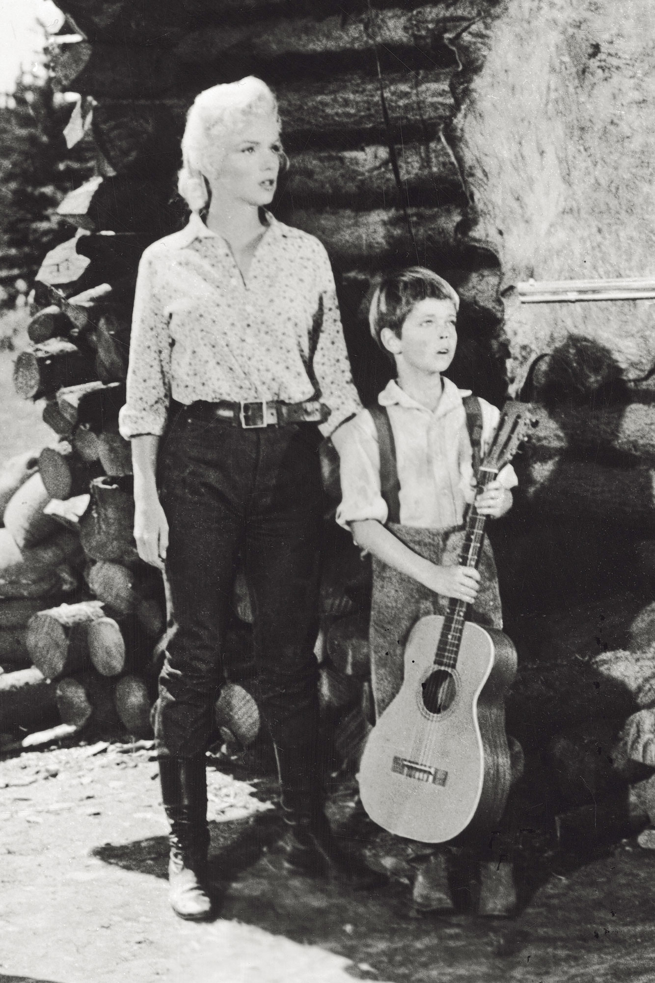 Marilyn Monroe, The Young Tommy Rettig And Rory Calhoun In A Scene Of A Film