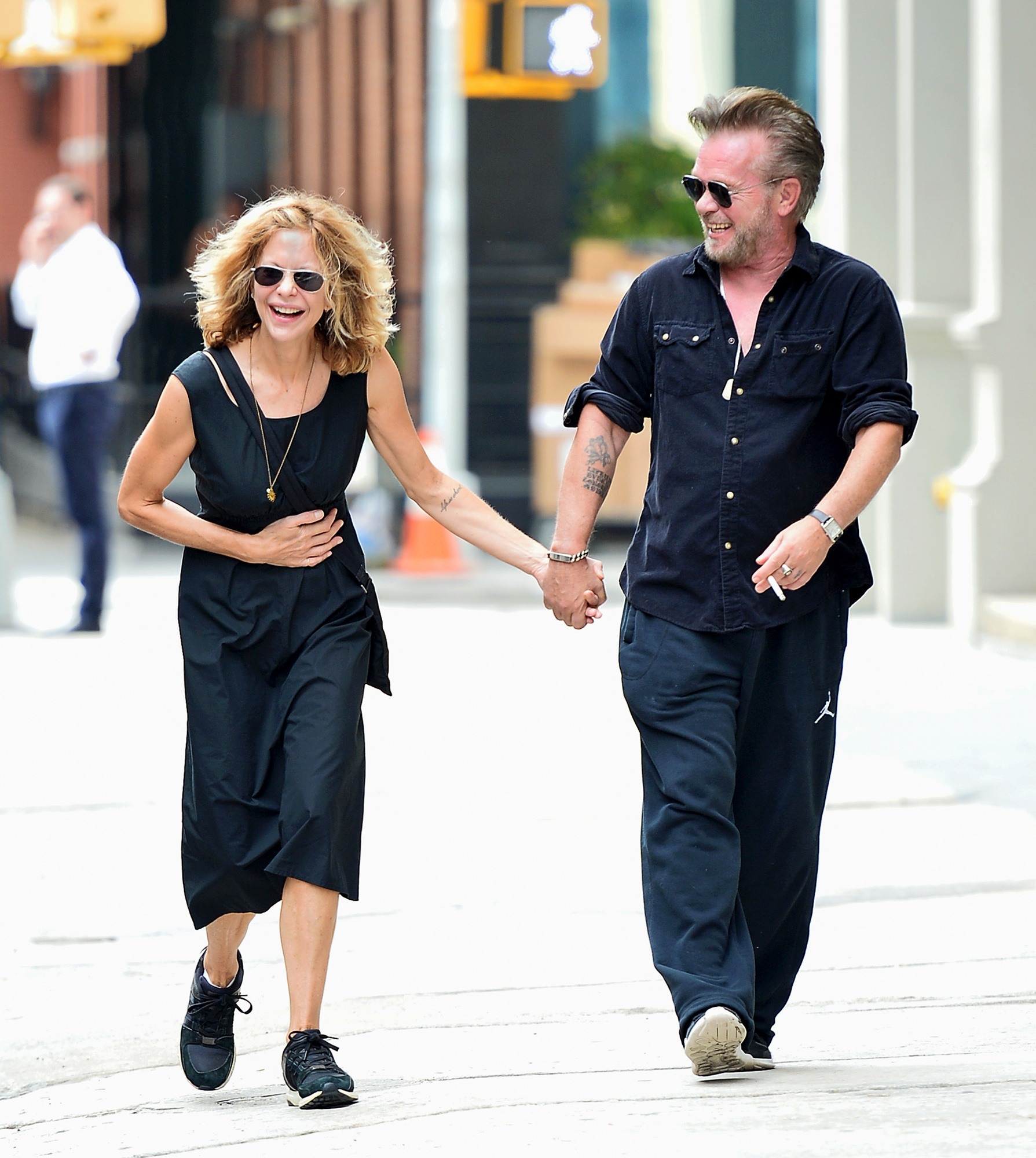 EXCLUSIVE: Meg Ryan and John Mellencamp hold hands and laugh together in NYC