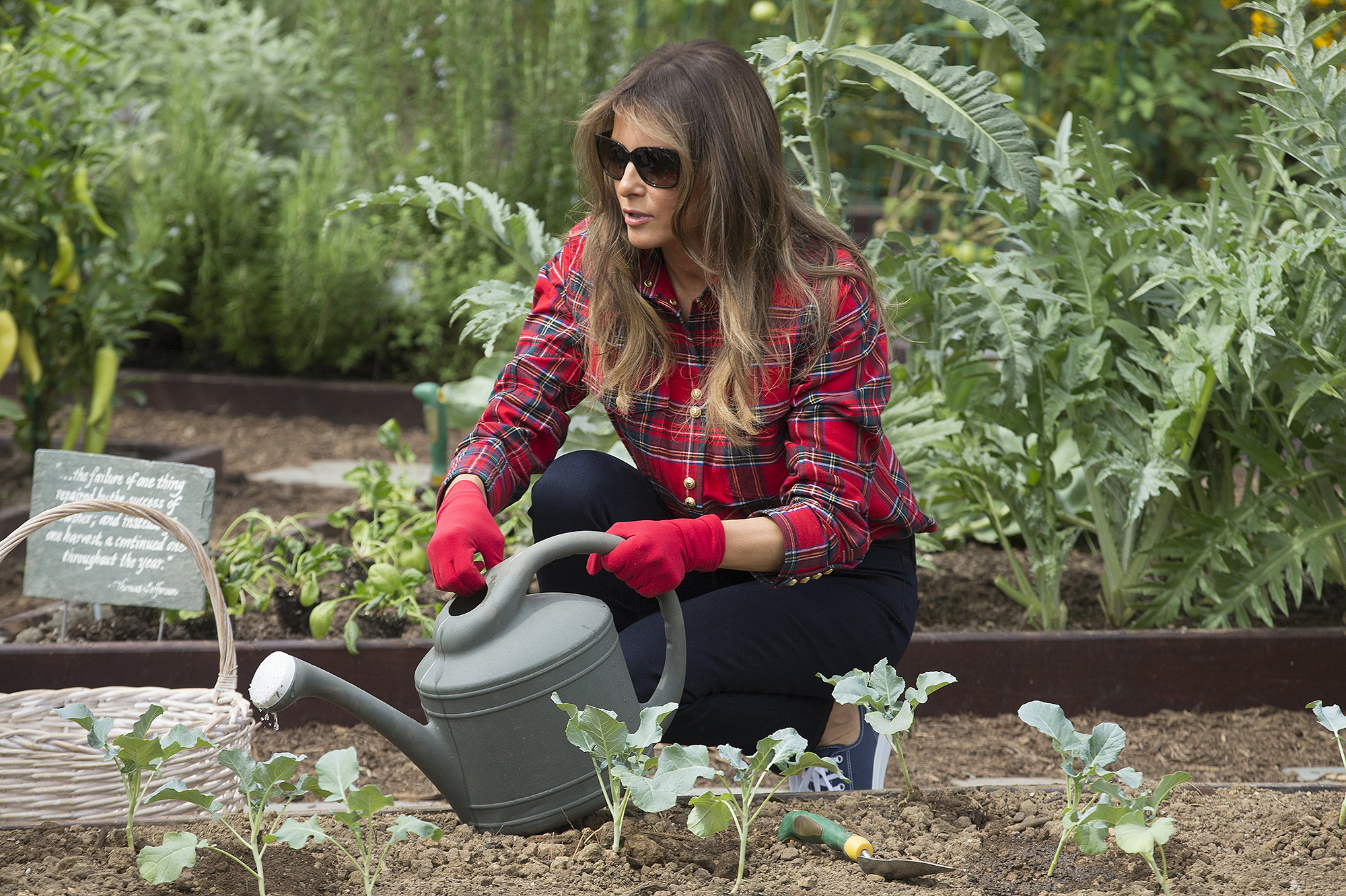 US First Lady Melania Trump harvests and plants vegetables with students from the Boys and Girls Club of Washington DC