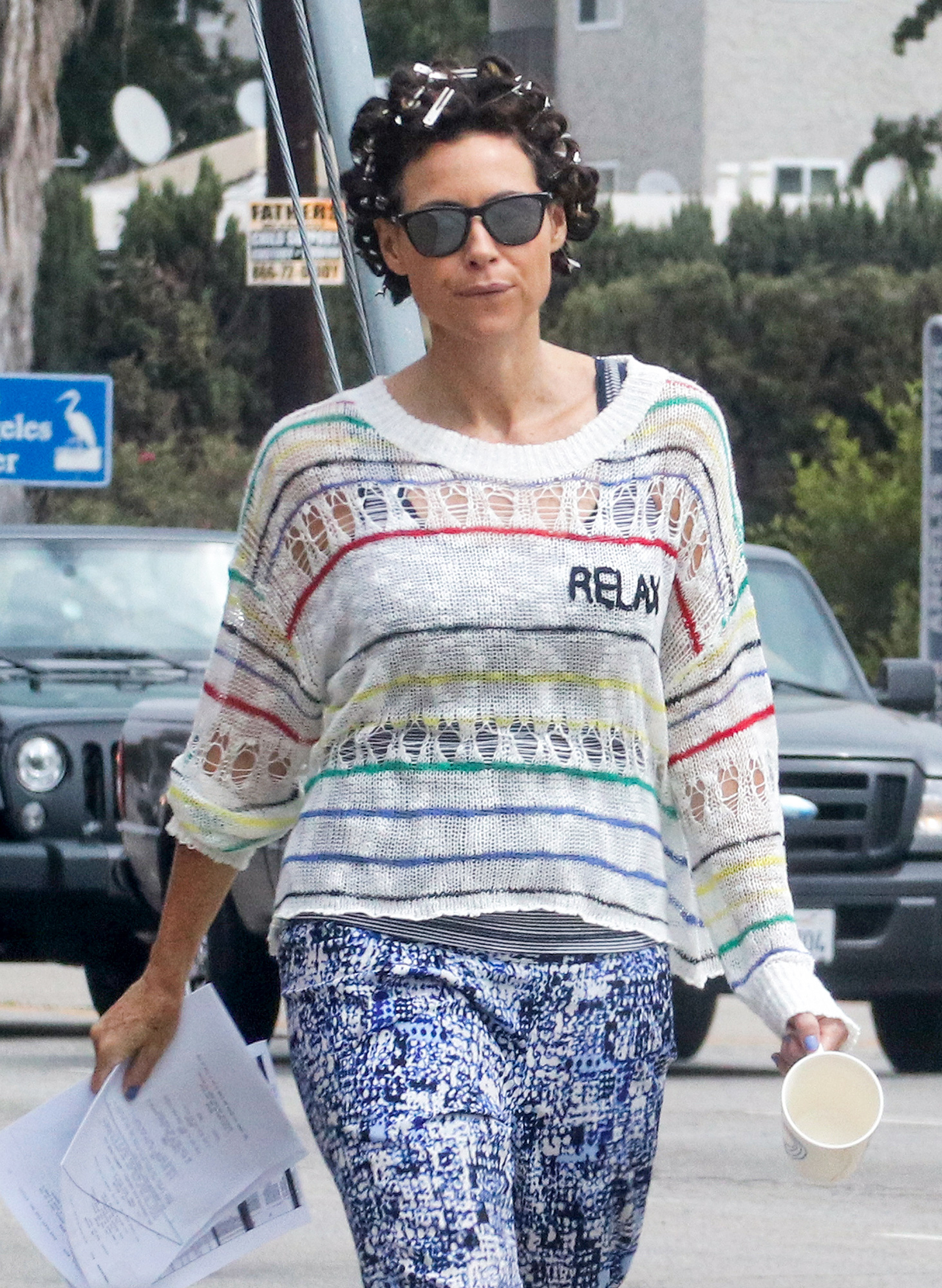 EXCLUSIVE: Minnie Driver in curlers on set