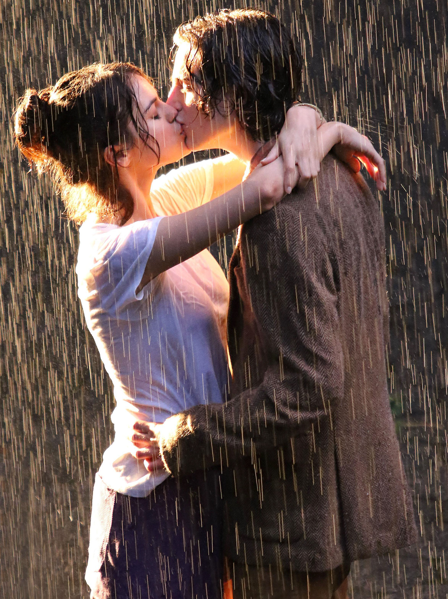 Selena Gomez and Timothee Chalamet kiss passionately in the rain during filming for Woody Allen's Untitled Movie Project in Manhattan's Central Park