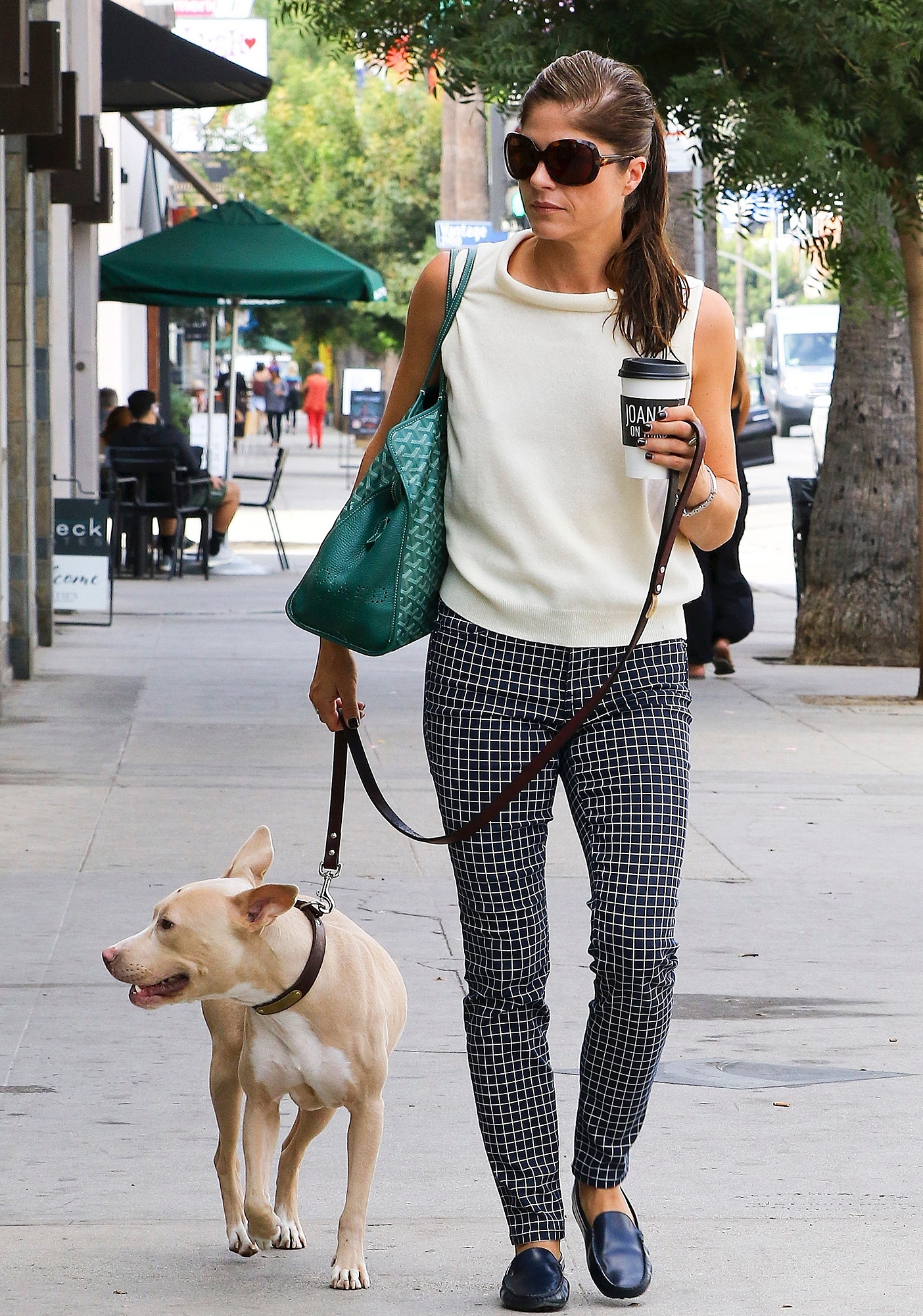 Selma Blair and her dog pick up a morning coffee from Joan's on Third