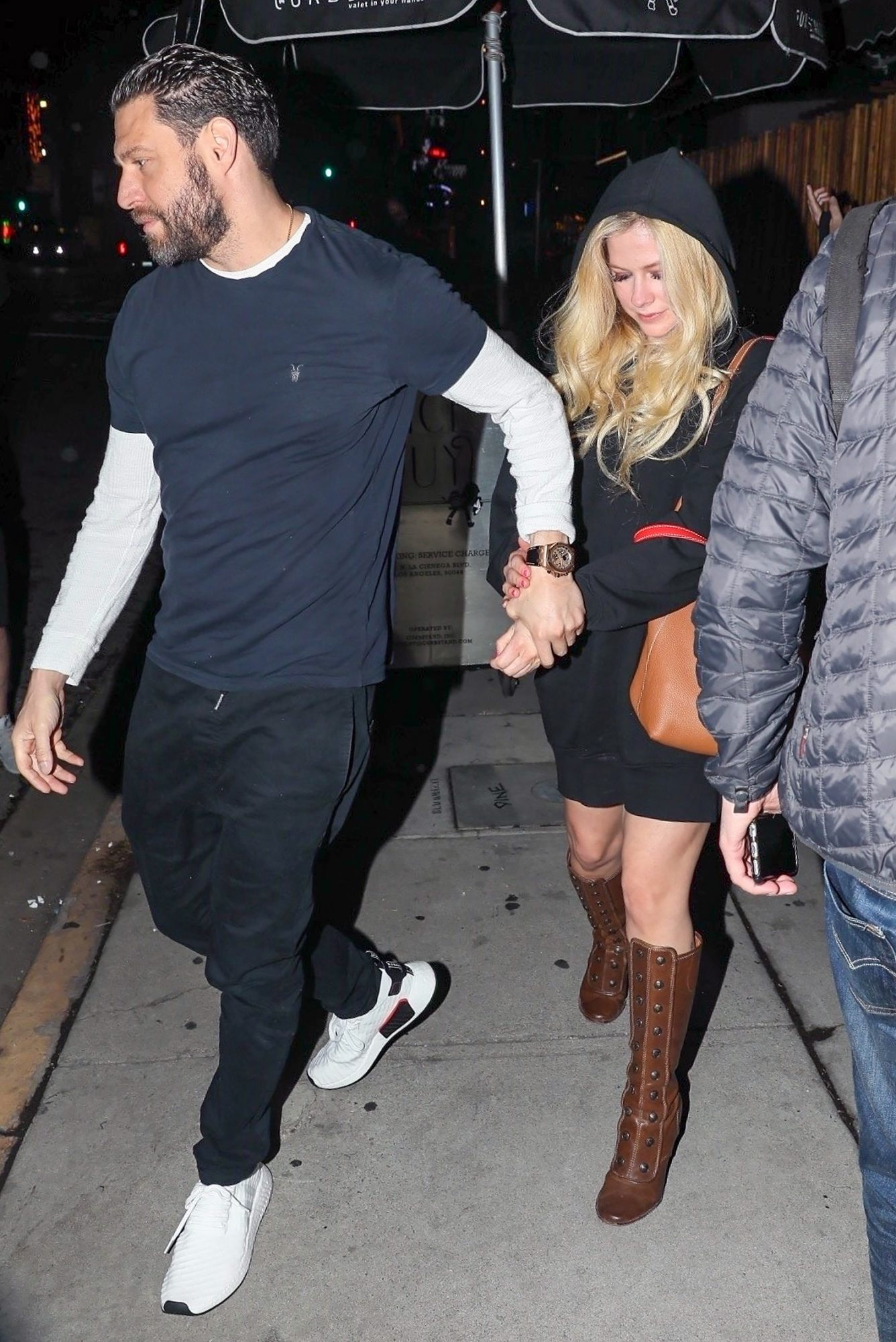 Avril Lavigne and J.R. Rotem hold hands at the Nice Guy