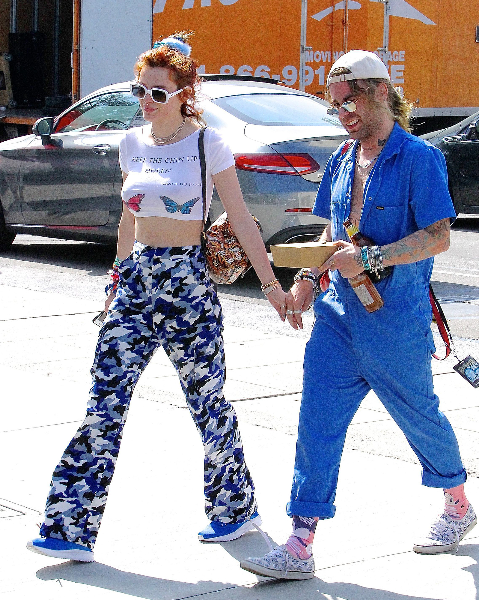 PDA alert! Bella Thorne flaunts her midriff in a colorful look while holding hands with rapper boyfriend Mod Sun