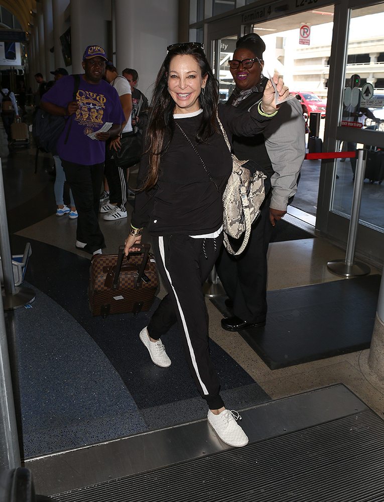 Heidi Fleiss departing at LAX Airport in Los Angeles