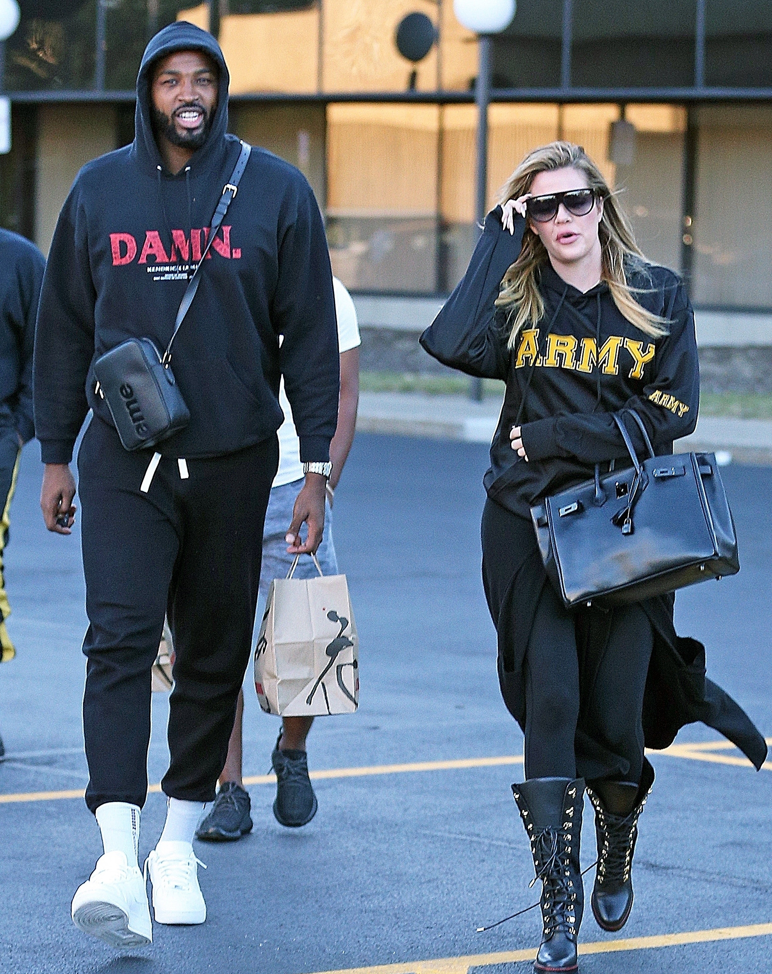 *PREMIUM-EXCLUSIVE* Khloe Kardashian hides her growing baby bump in a baggy hoodie while out with Tristan Thompson