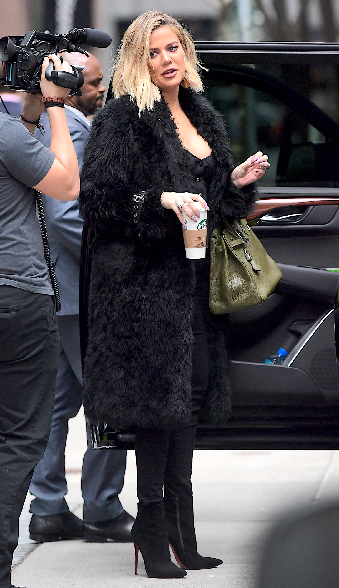 """EXCLUSIVE: """"Pregnant"""" Khloe Kardashian Displays a Hint of a Baby Bump as she Wears Towering Heels in NYC"""