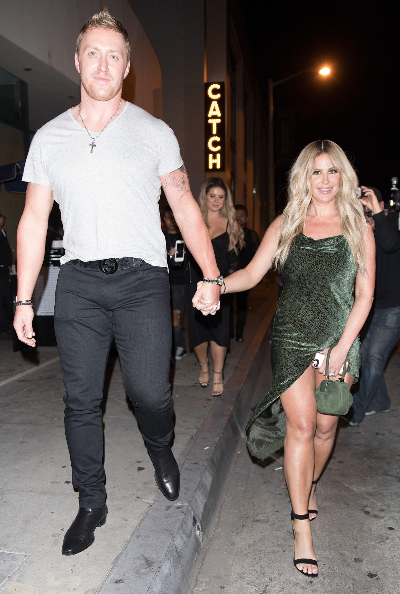 Kim Zolciak and her boyfriend are seen leaving Catch in West Hollywood