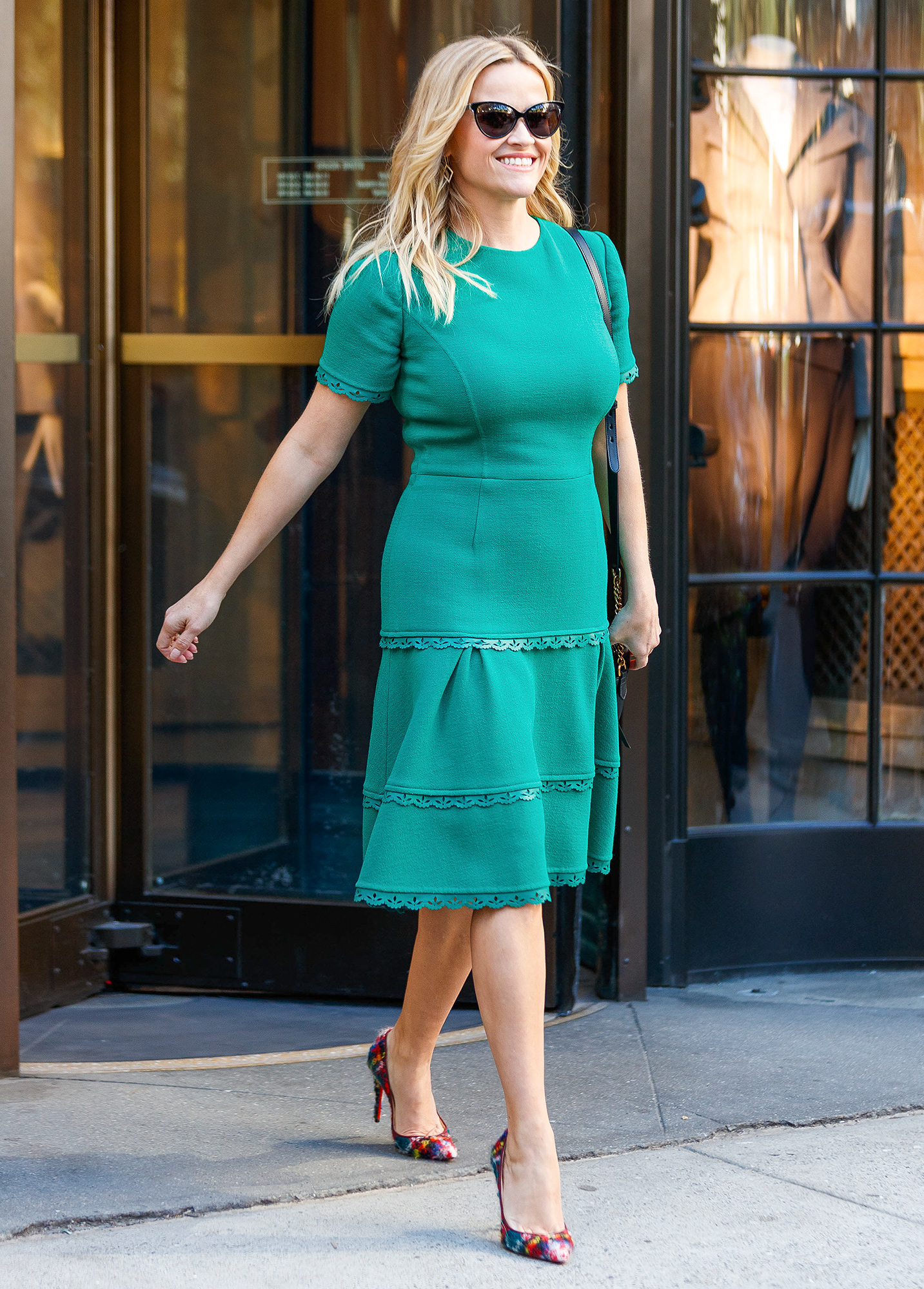 EXCLUSIVE: Reese Witherspoon wears a turquoise dress paired with rainbow colored pumps in New York