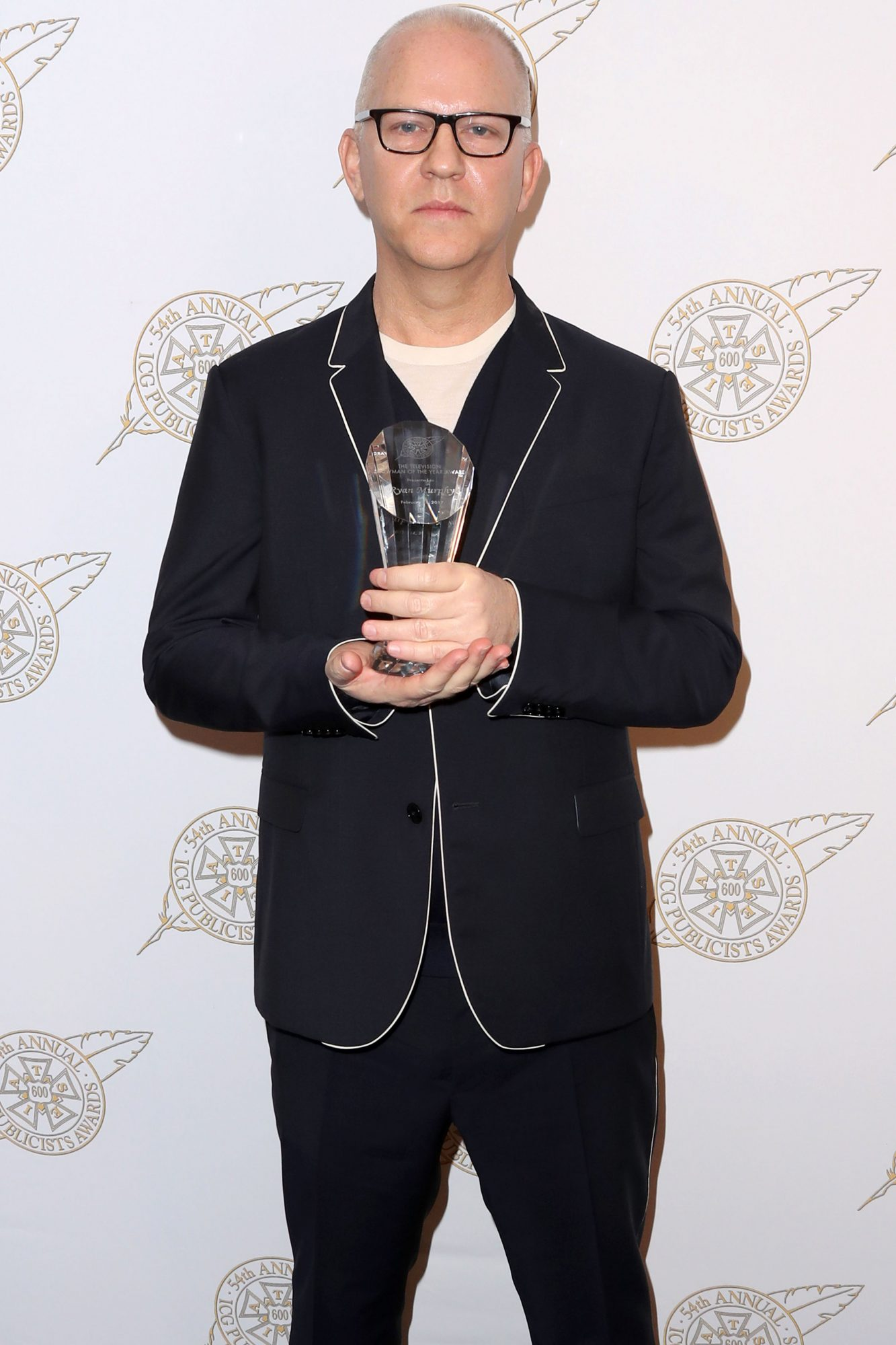 BEVERLY HILLS, CA - FEBRUARY 24: Screenwriter Ryan Murphy poses with his Television Showman of the Year award backstage at the 54th Annual International Cinematographers Guild Publicists Awards at The Beverly Hilton Hotel on February 24, 2017 in Beverly Hills, California. (Photo by Frederick M. Brown/Getty Images)