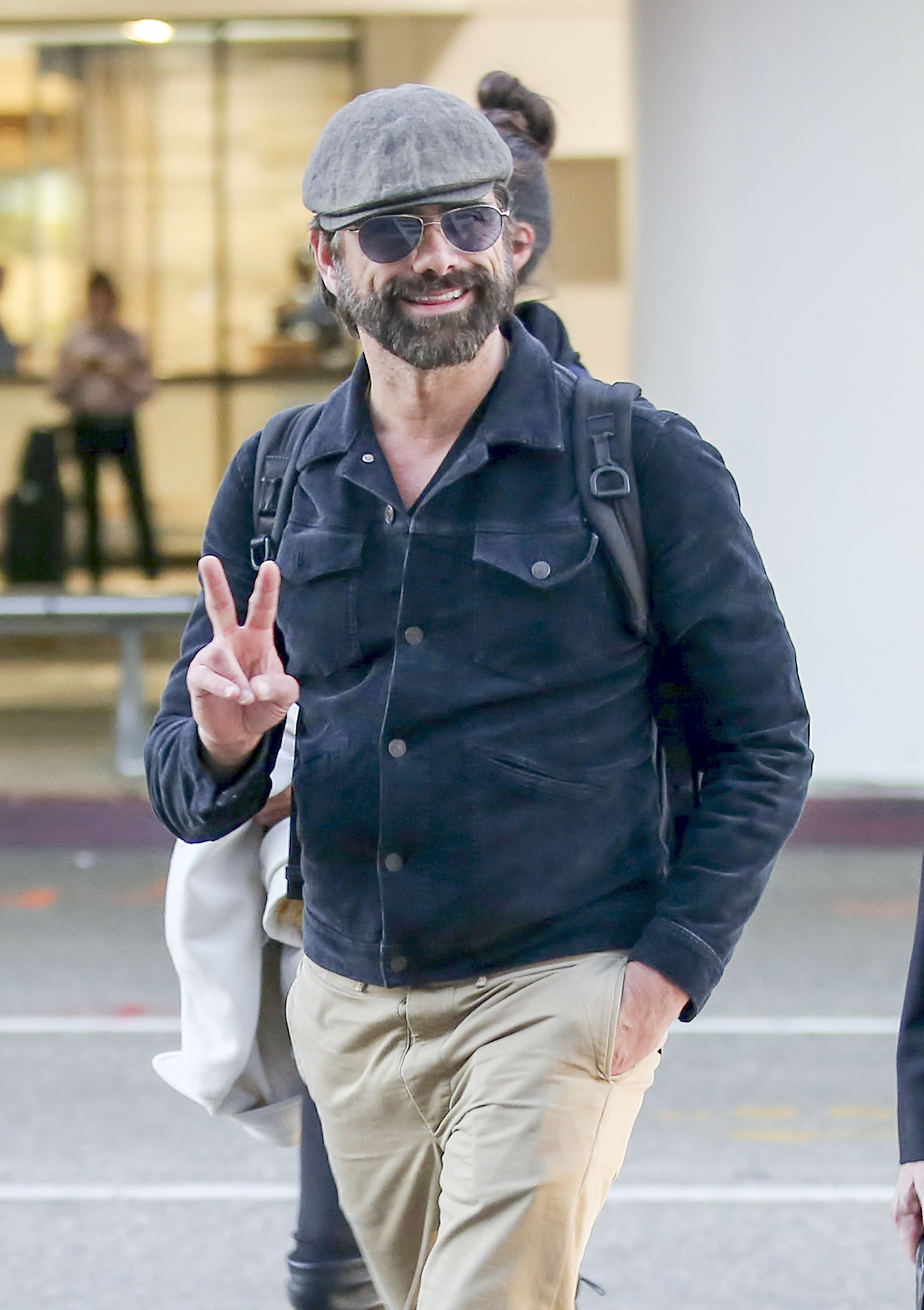EXCLUSIVE: John Stamos is seen at LAX airport in Los Angeles