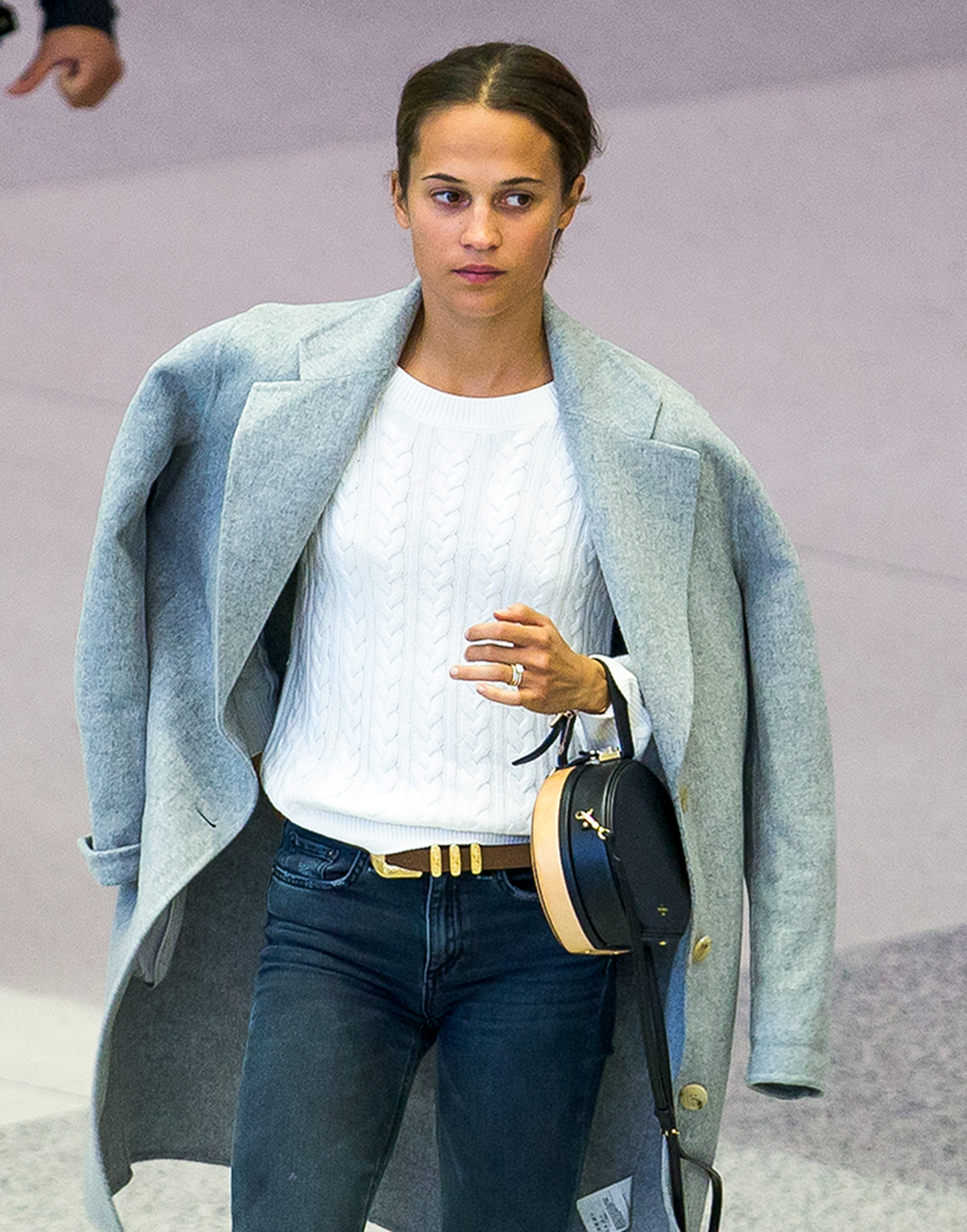 EXCLUSIVE: Newlywed Alicia Vikander shows off her wedding ring as she arrives in Miami without husband Michael Fassbender.