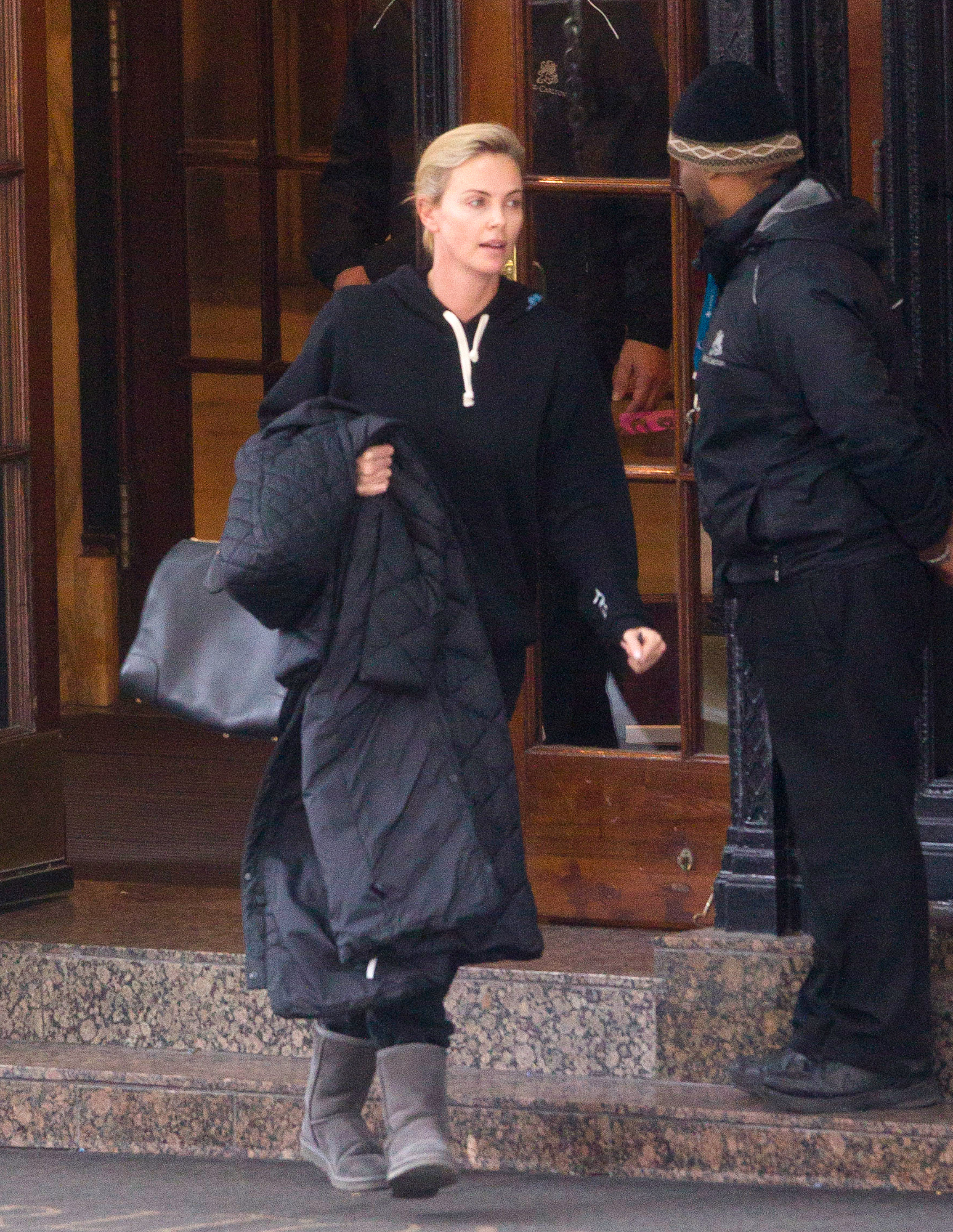 EXCLUSIVE: Charlize Theron is Spotted Makeup Free Leaving a Montreal Hotel