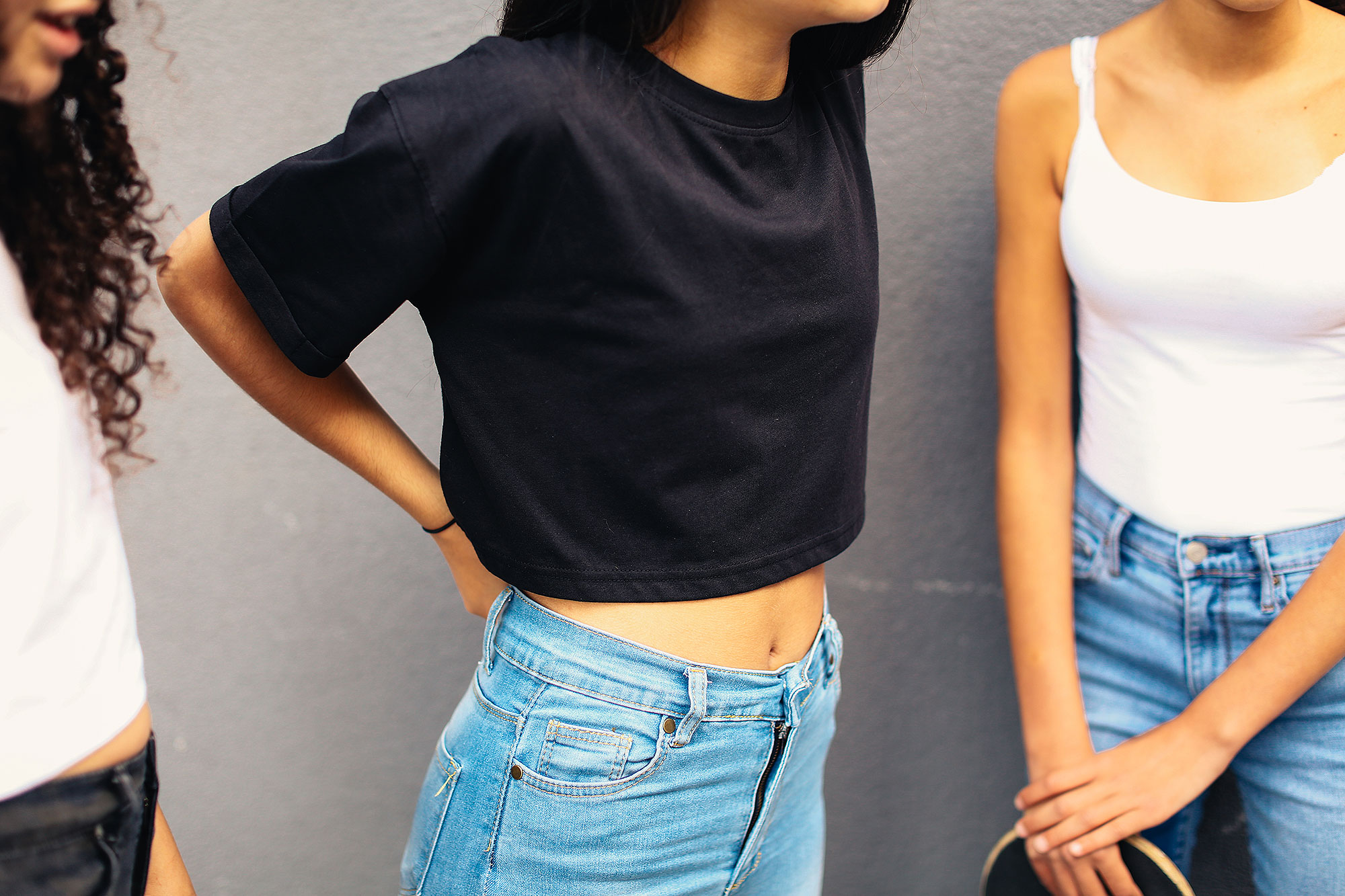 Crop of teenage girls wearing jeans