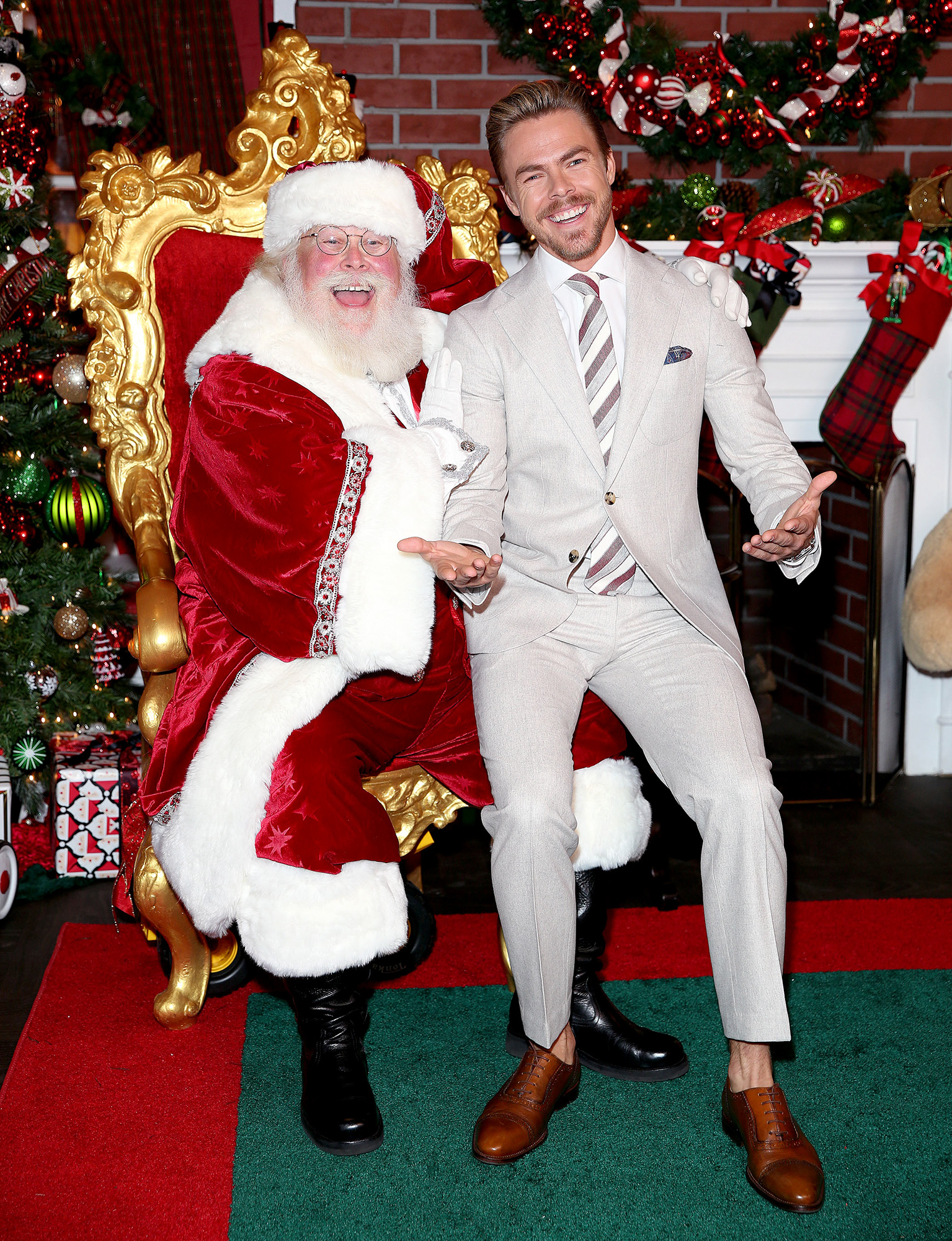 **EXCLUSIVE**  Photo Credit: MOVI Inc.  Date: November 16th 2017Derek Hough takes a seat on Santa's knee before hosting The Americana At Brand's Christmas Tree lighting show in Glendale,CA.