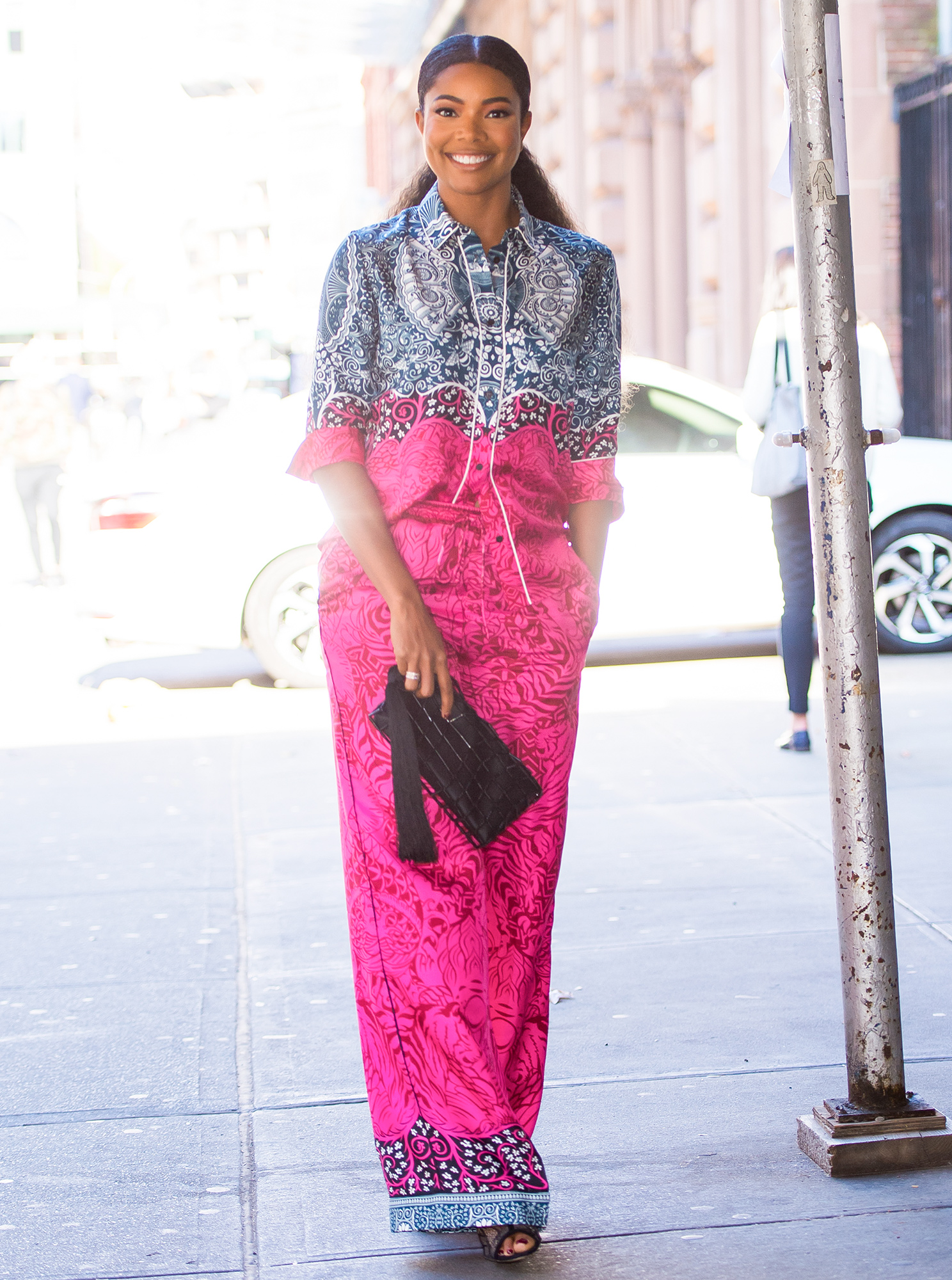 EXCLUSIVE: Gabrielle Union is seen wearing a hot pink and navy blue patterned one piece in New York City