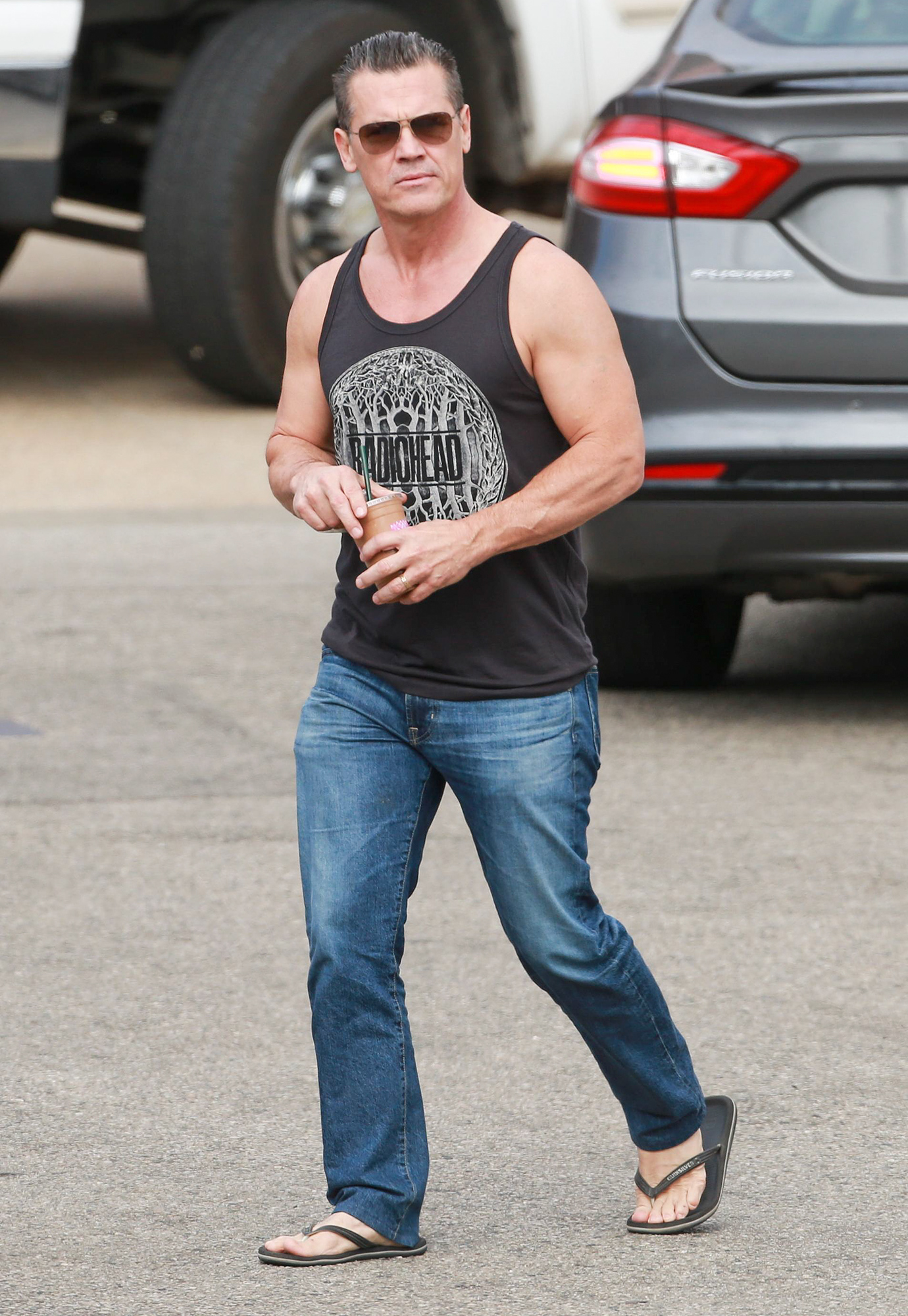 EXCLUSIVE: Josh Brolin shows off his toned biceps as he is spotted grabbing a smoothie with wife Kathryn Boyd in Malibu