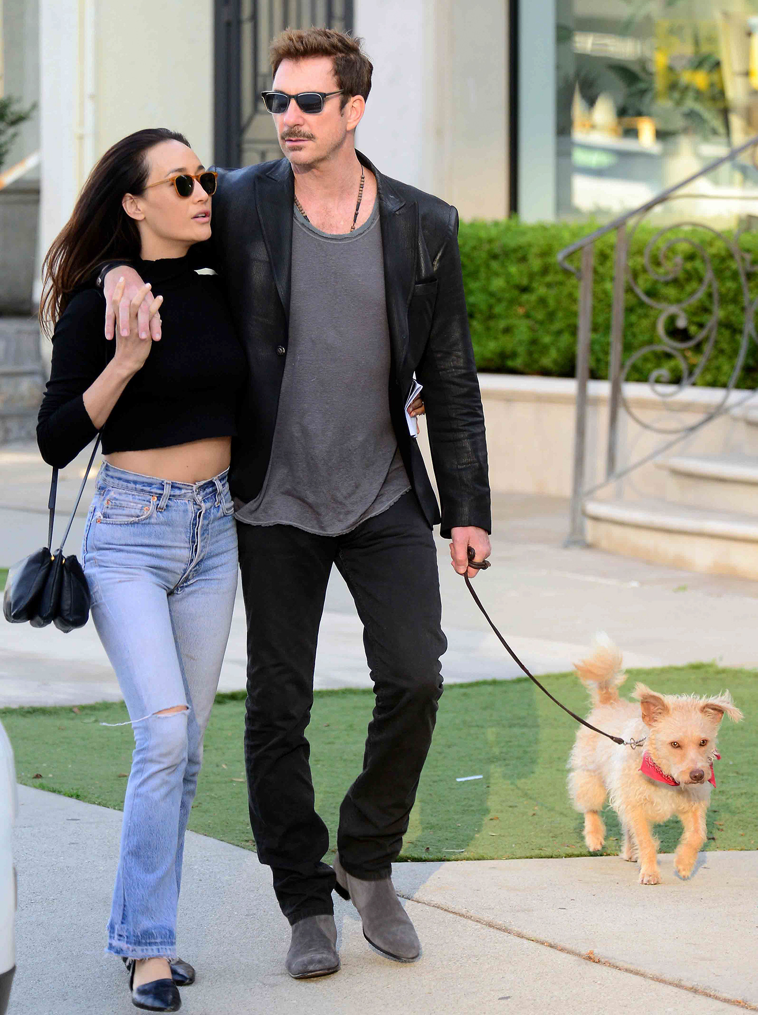 EXCLUSIVE: Dylan McDermott and Maggie Q walk their dog along Melrose Avenue