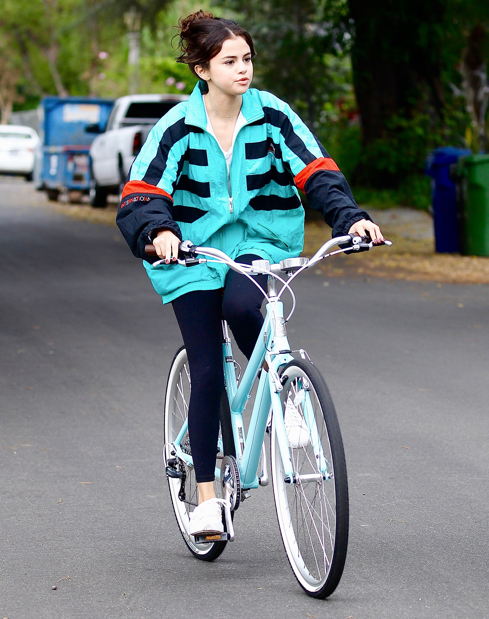 Selena Gomez goes out for a bike ride on Halloween