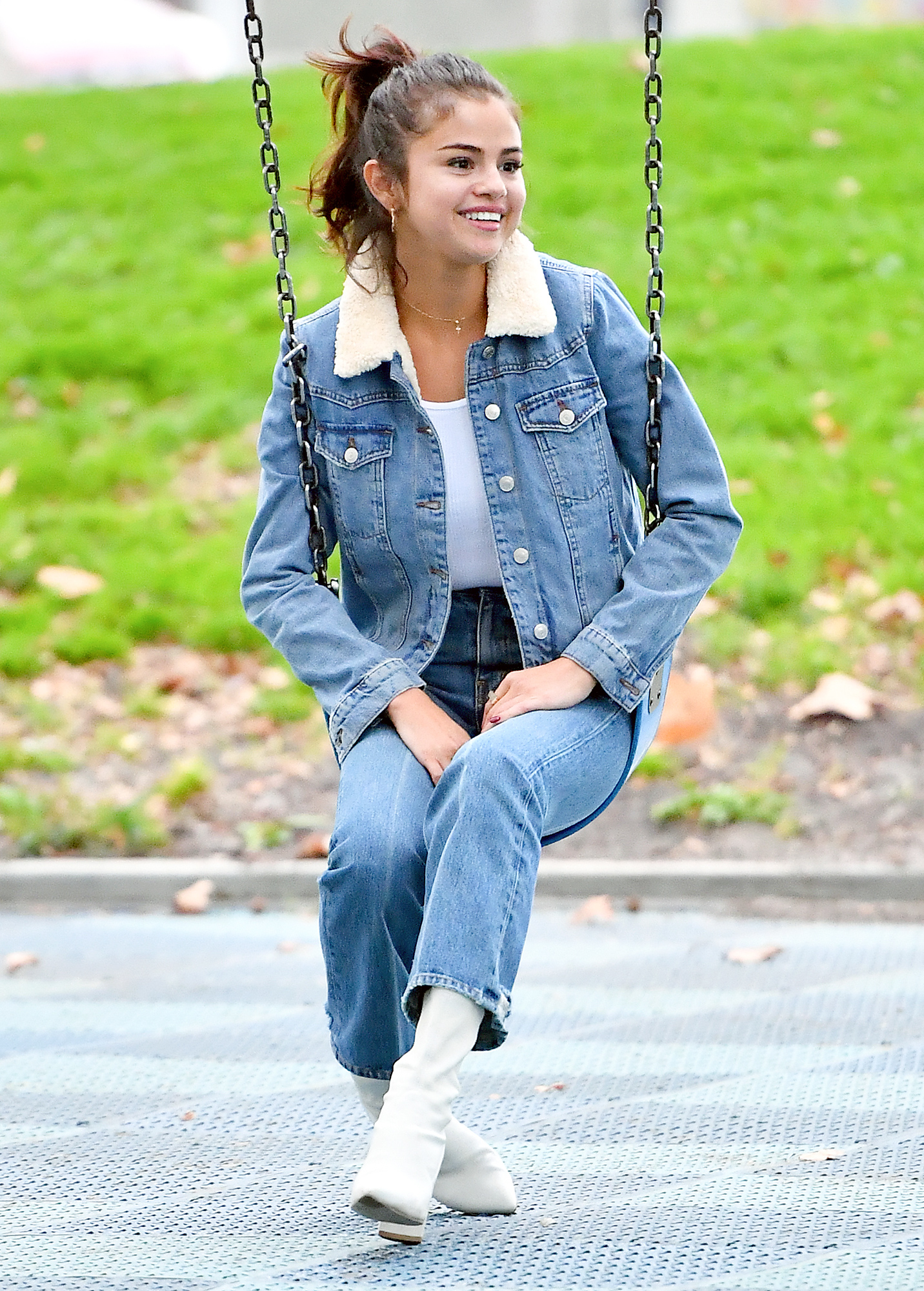 Selena Gomez looks incredibly happy while on the swings at a local park in Burbank