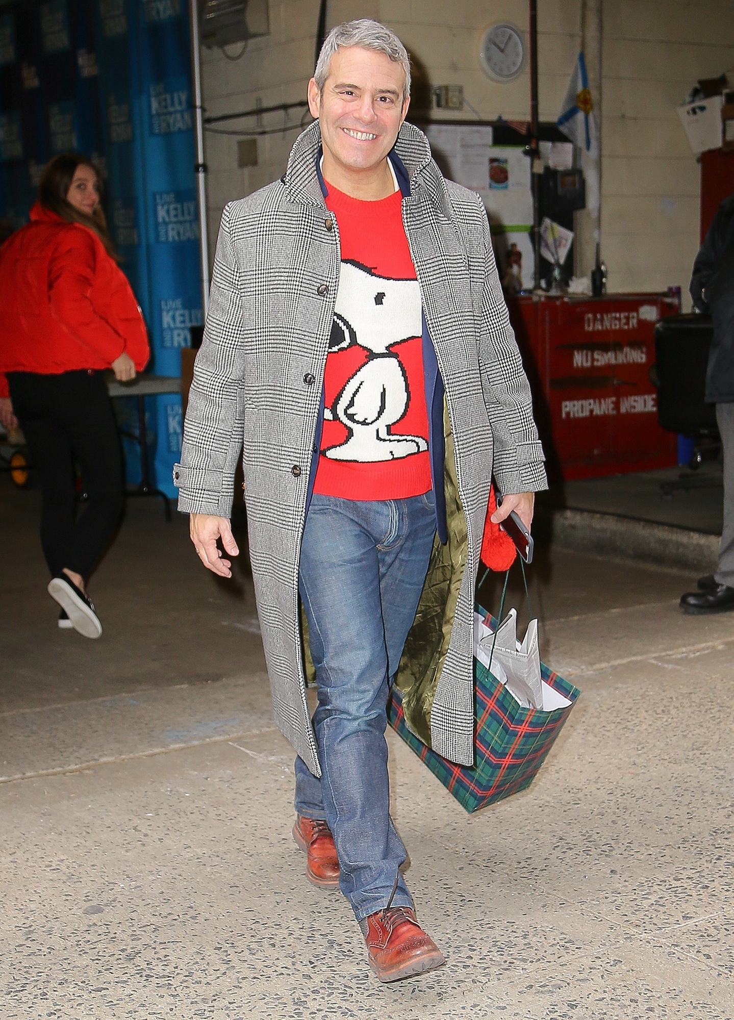*EXCLUSIVE* Andy Cohen wears his favorite Snoopy sweater after Live! With Kelly and Ryan
