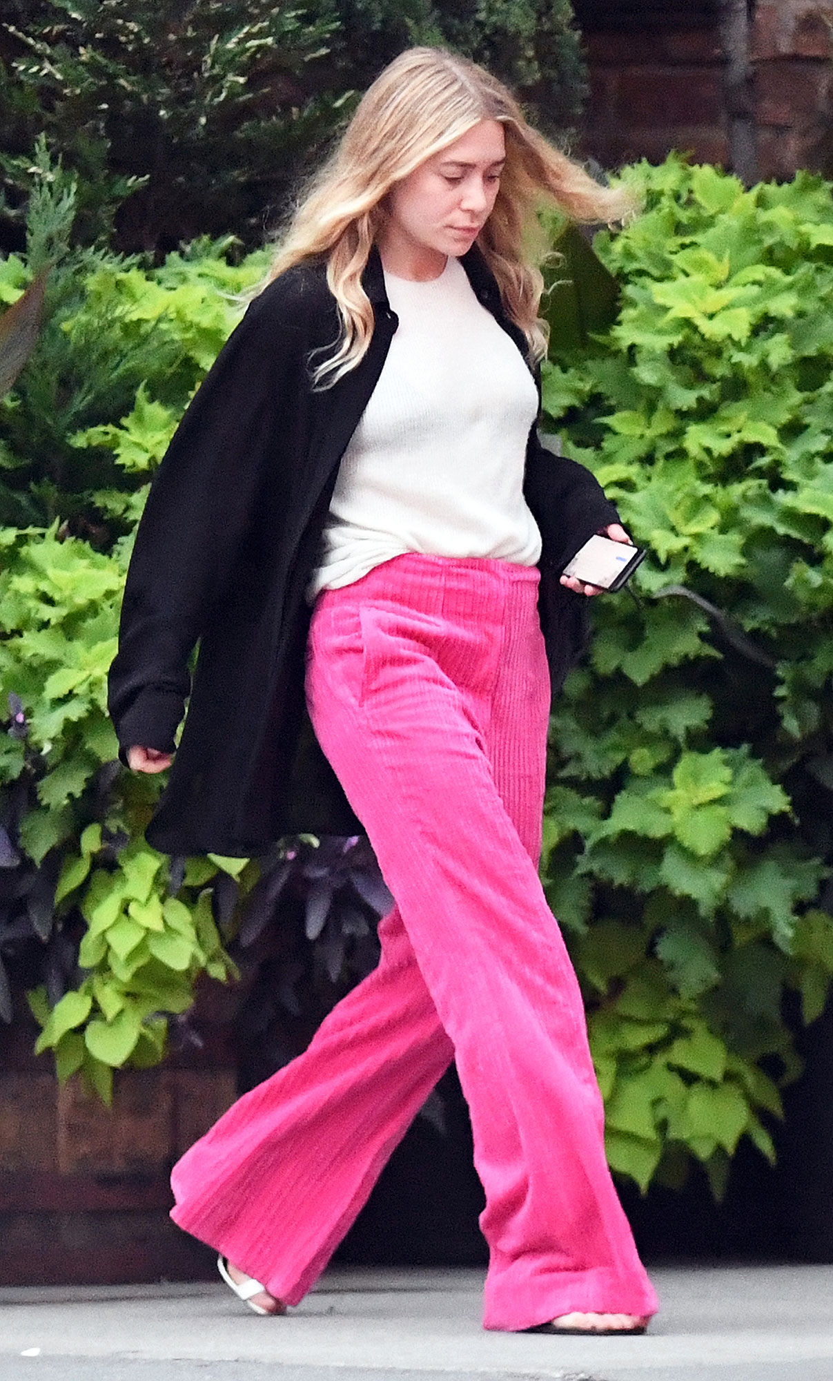 EXCLUSIVE: Ashley Olsen Spotted leaving her Hotel wearing a pink pants