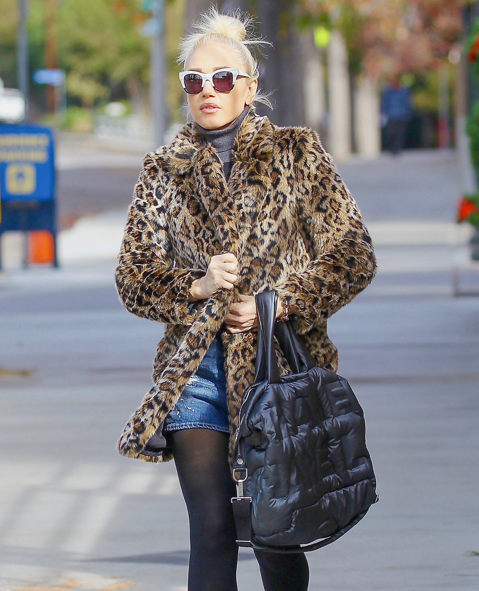 Gwen Stefani steps out to Christmas shop in a leopard print coat.