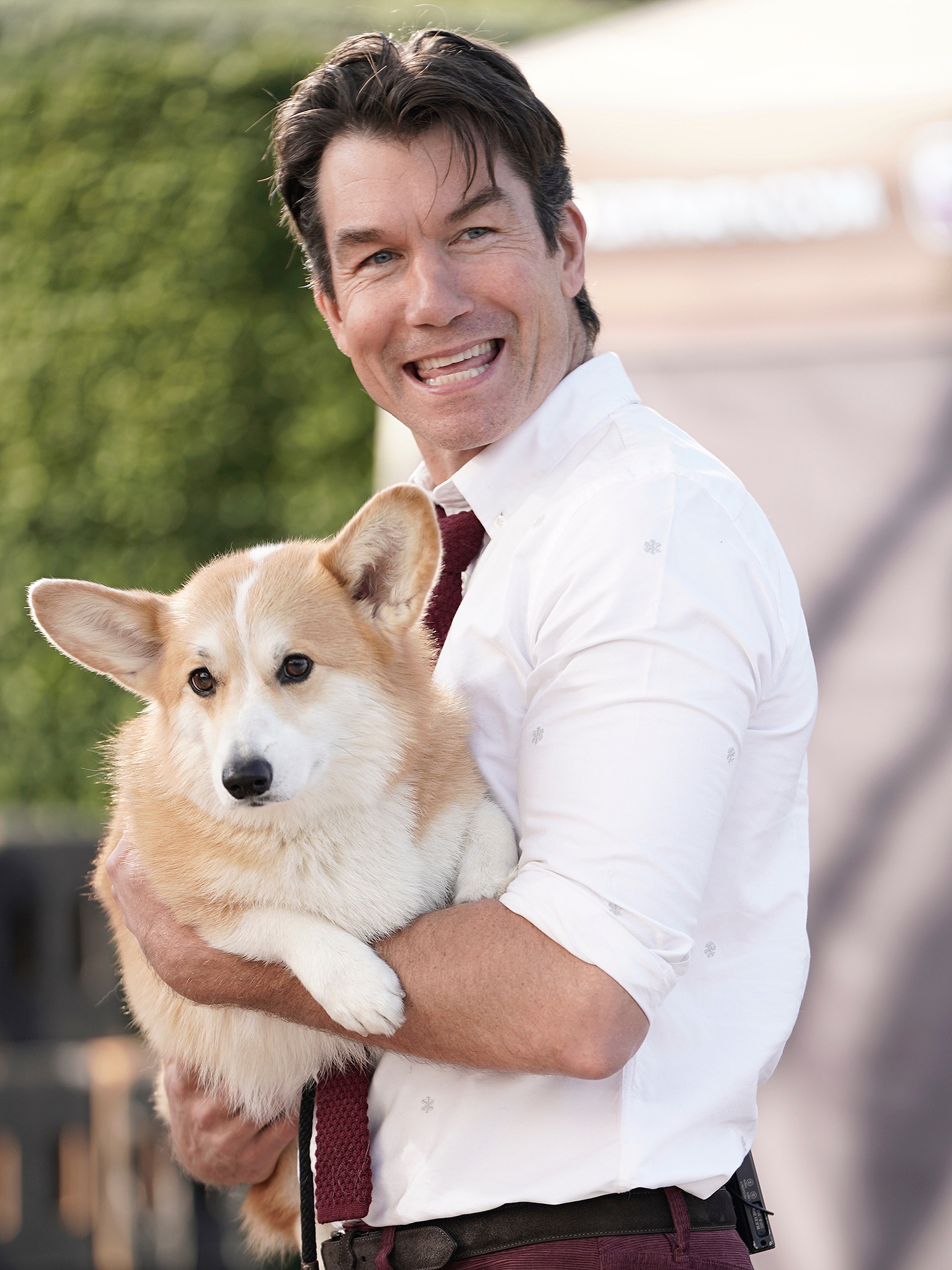 Actor Jerry O'Connell is seen holding a Corgi dog while on the set of EXTRA TV in Los Angeles.