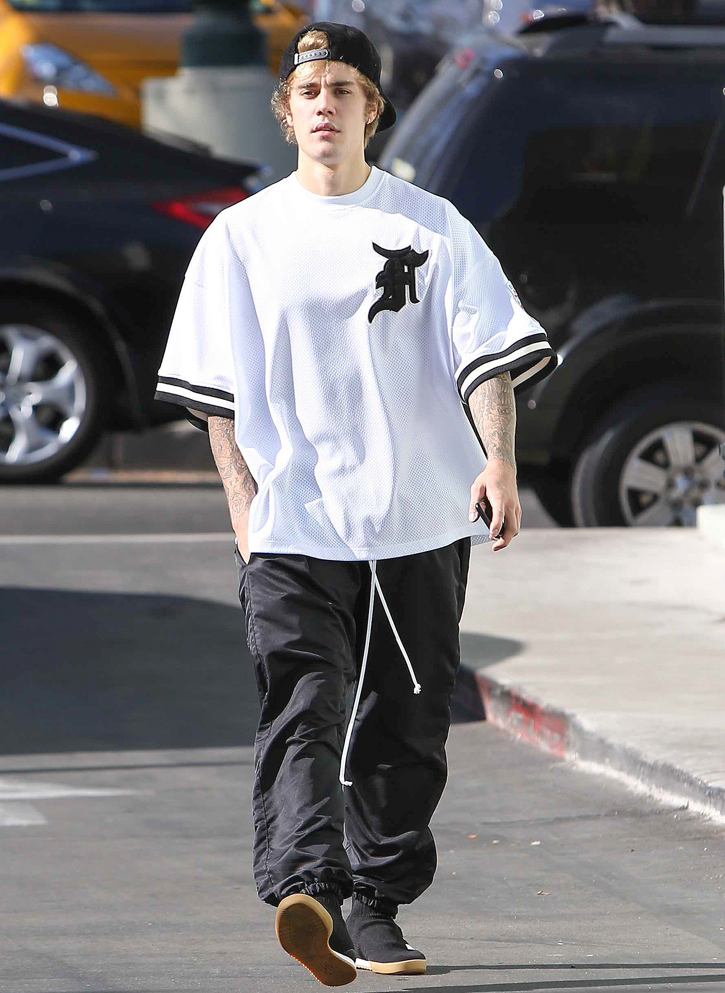 Justin Bieber looks down cast about Head of security getting arrested for DIU CAR ACCIDENT