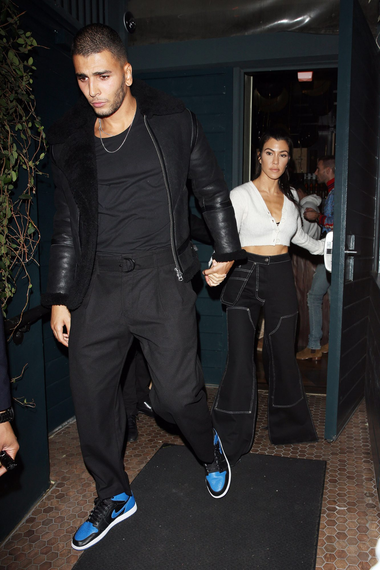 Kourtney Kardashian and Younes Bendjima walk hand in hand out of Le petit Restaurant after celebrating Kendall Jenner's 22nd Birthday Party