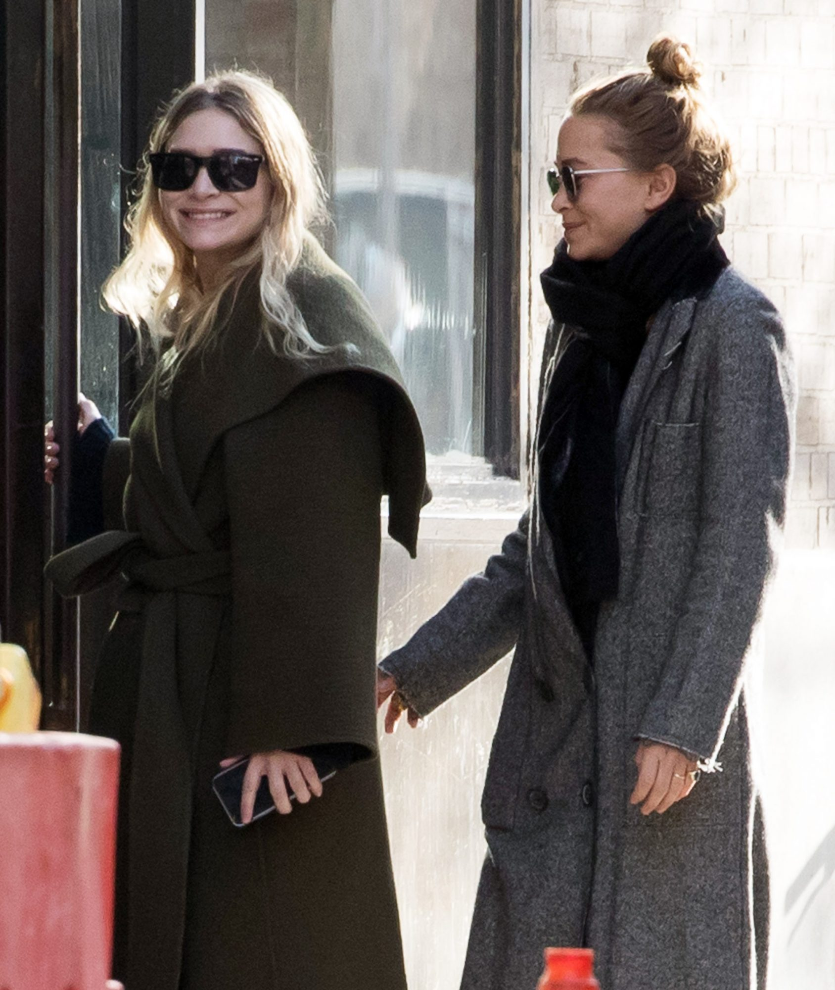 EXCLUSIVE: Mary-Kate Olsen and Ashley Olsen seen smiling after having a cigarette break outside there office in New York.