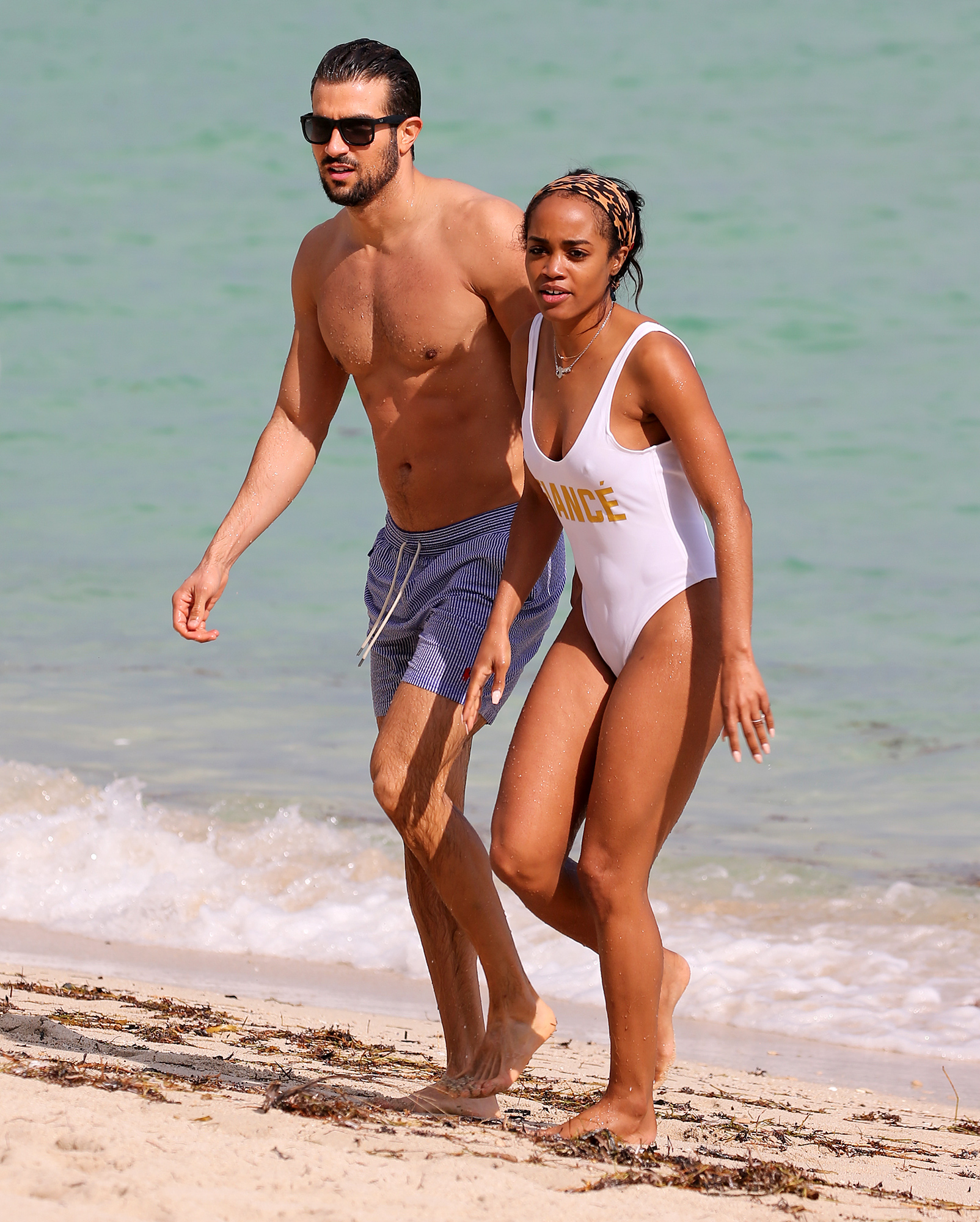 The Bachelorette Rachel Lindsay and her fiancÈ Bryan Abosolo show off their beach bodies and plenty of PDA as they take a dip in the ocean in Miami