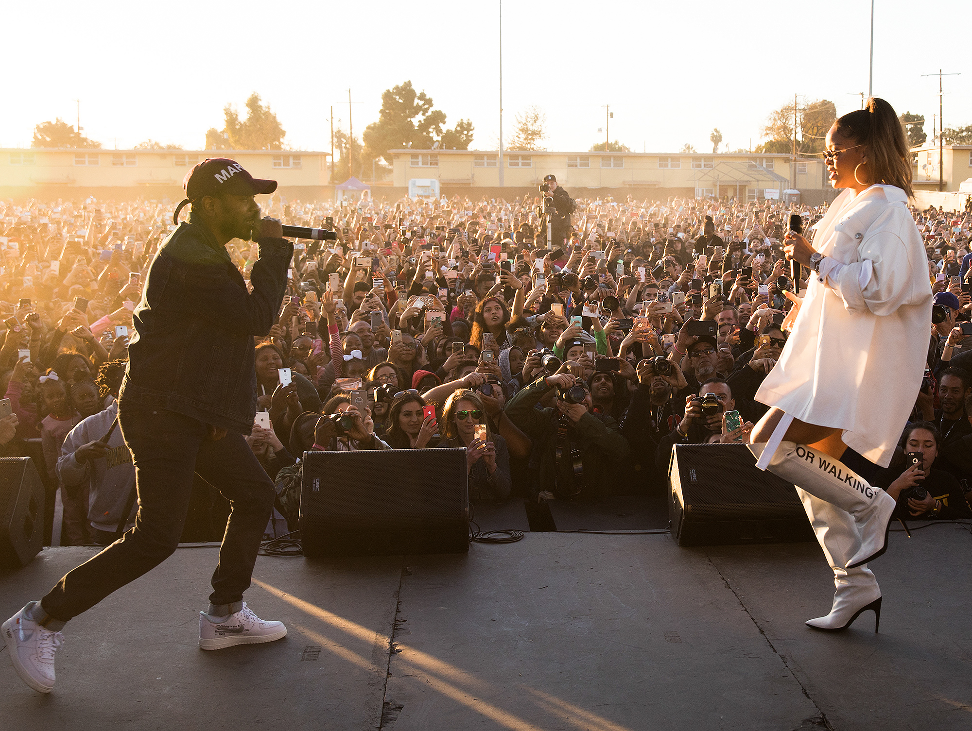 EXCLUSIVE: Rihanna and Kendrick Lamar are both seen performing together on stage at the TDE Annual Christmas Concert held in Watts, CA