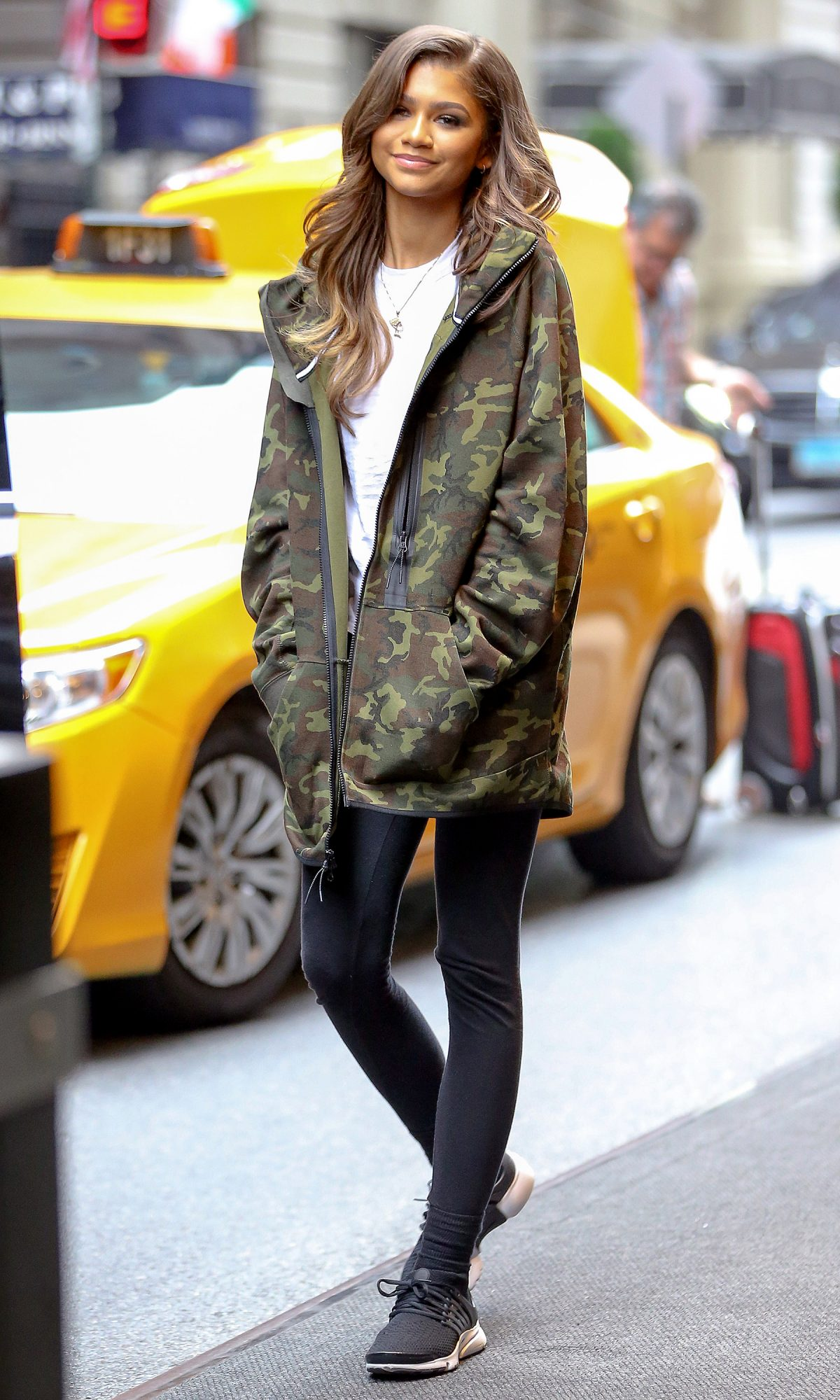 *EXCLUSIVE* Zendaya makes casual look sophisticated in camo and curls