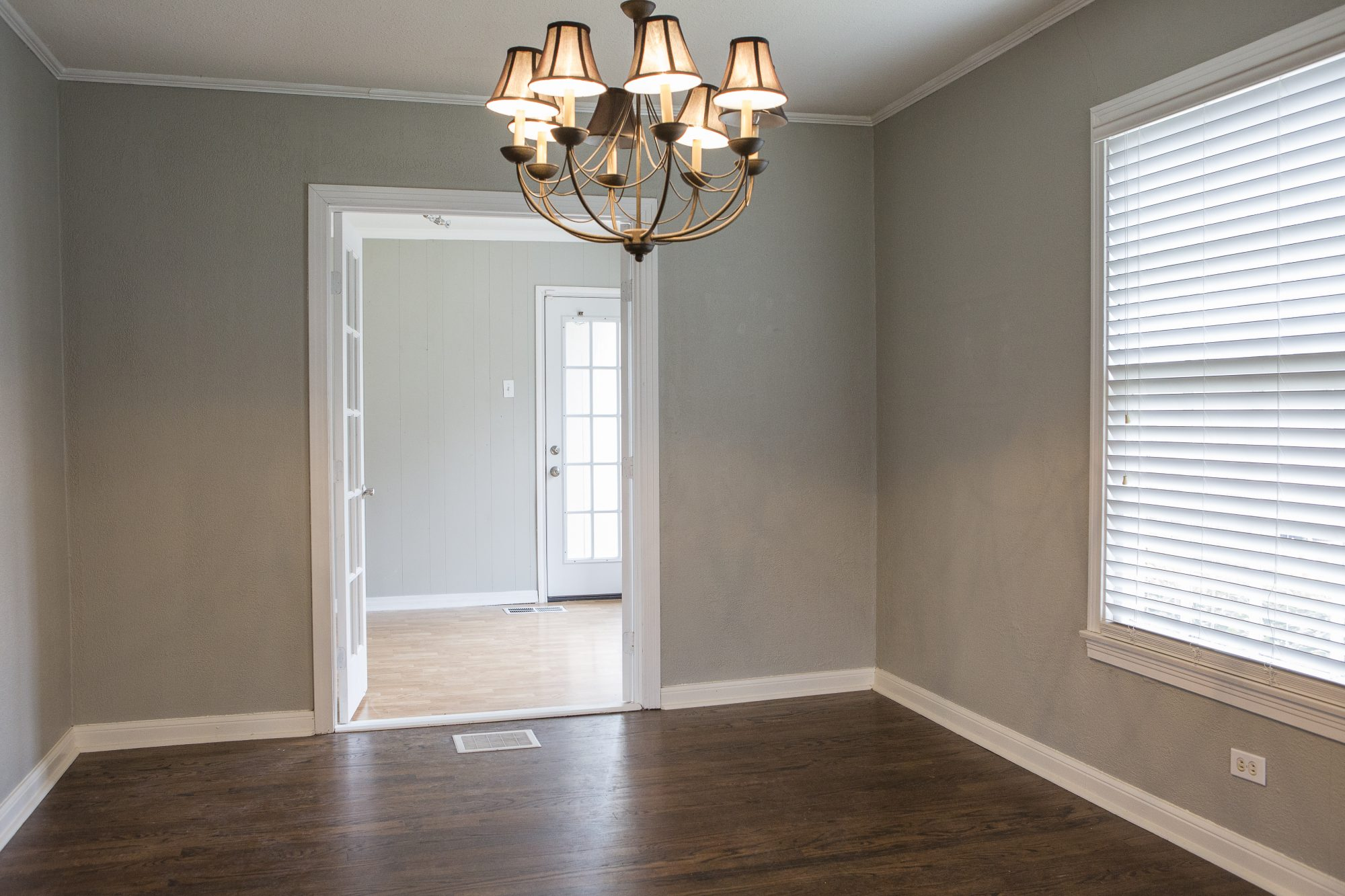 As seen on FIxer Upper, the dining room of the Baker's home. (Before)