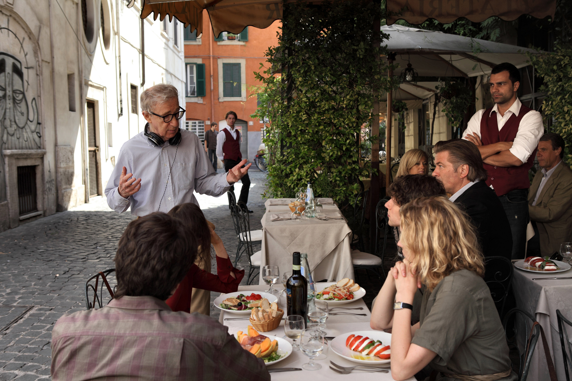TO ROME WITH LOVE, director Woody Allen (standing) with seated right from rear: Alec Baldwin, Jesse