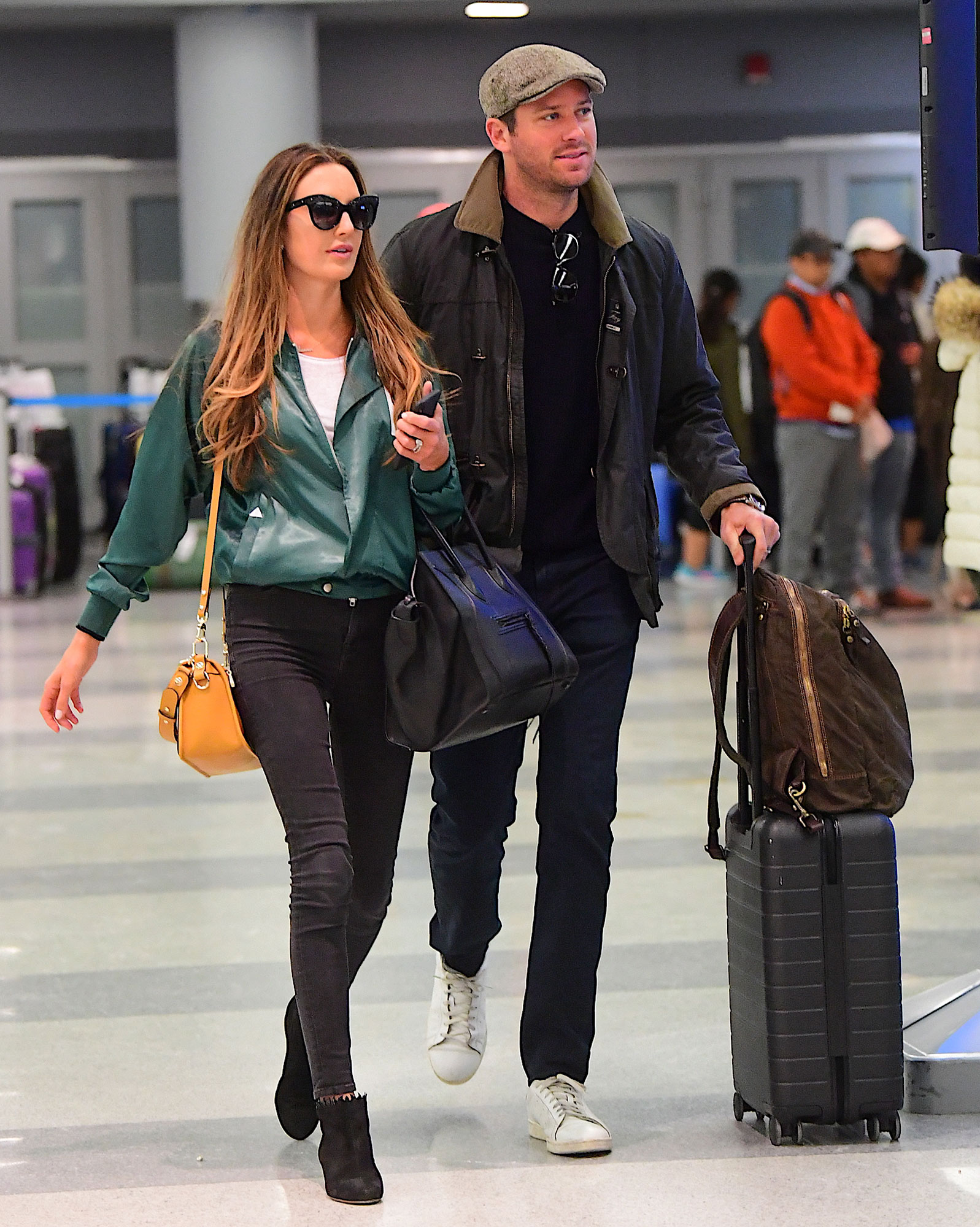 Armie Hammer and Wife Elizabeth Chambers Jet into NYC with Timothy Chalamet
