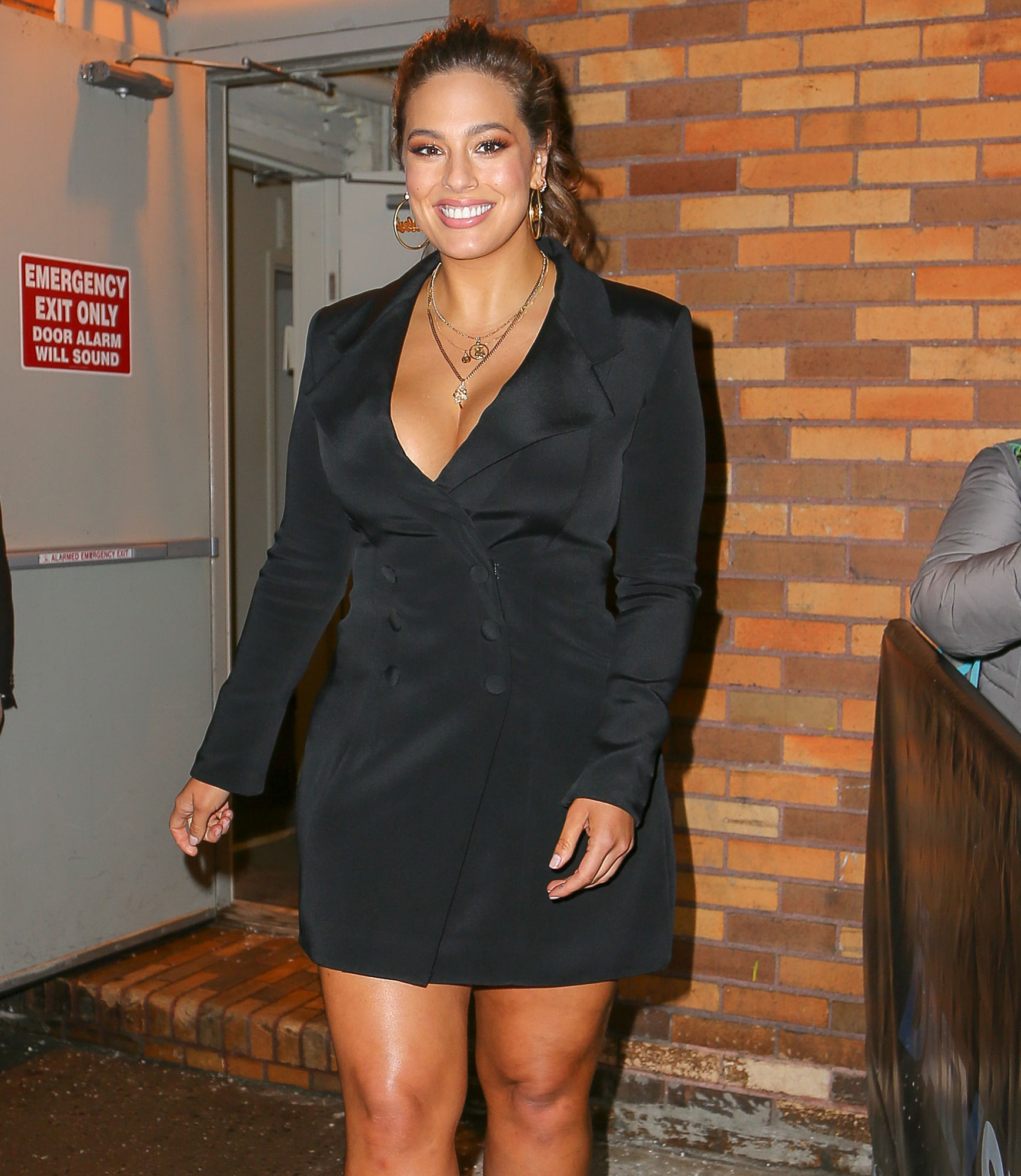 Ashley Graham seen wearing a mini coat dress as leaving The Daily Show with Trevor Noah in New York City