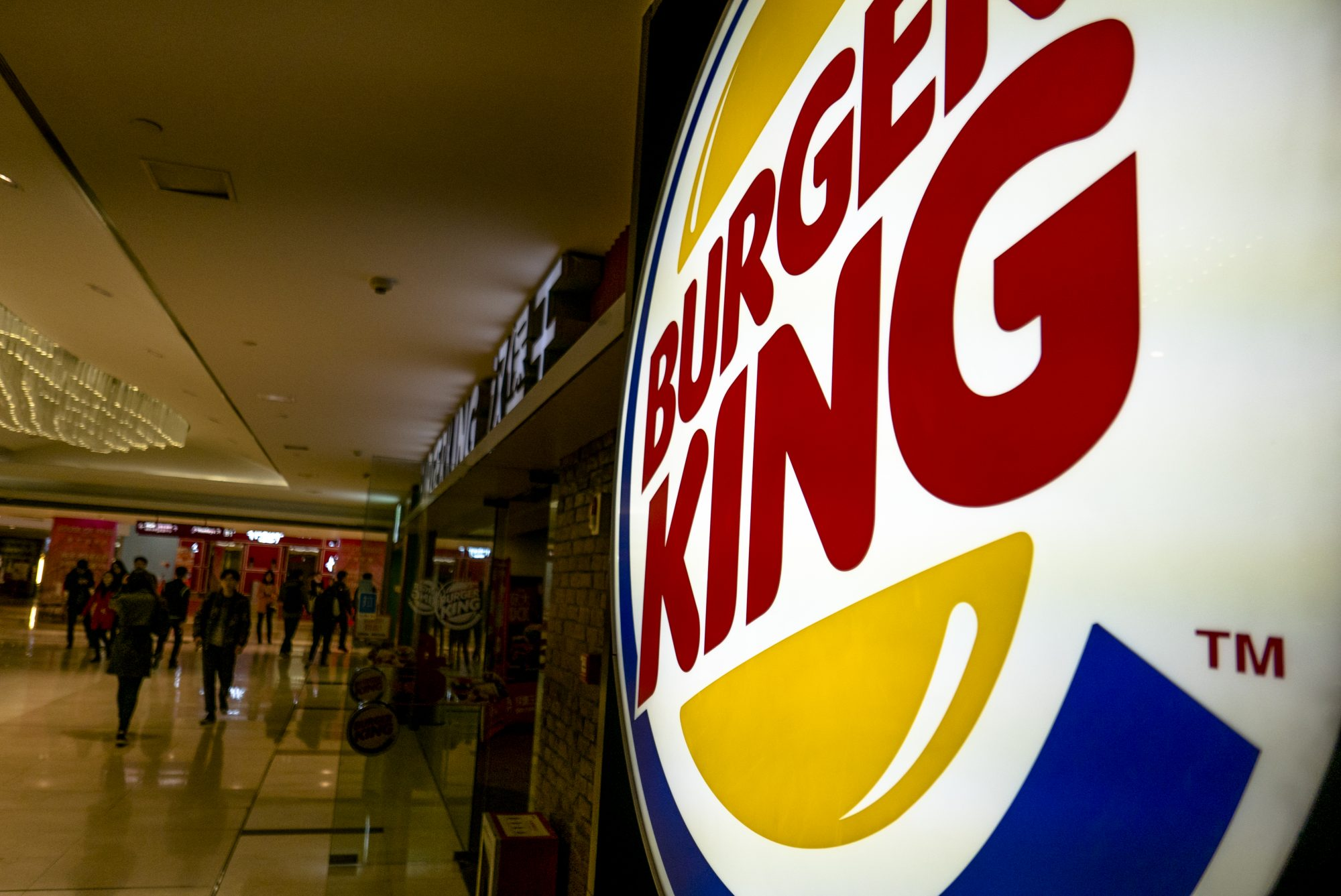 Lightbox logo of Burger King in a shopping mall.  While