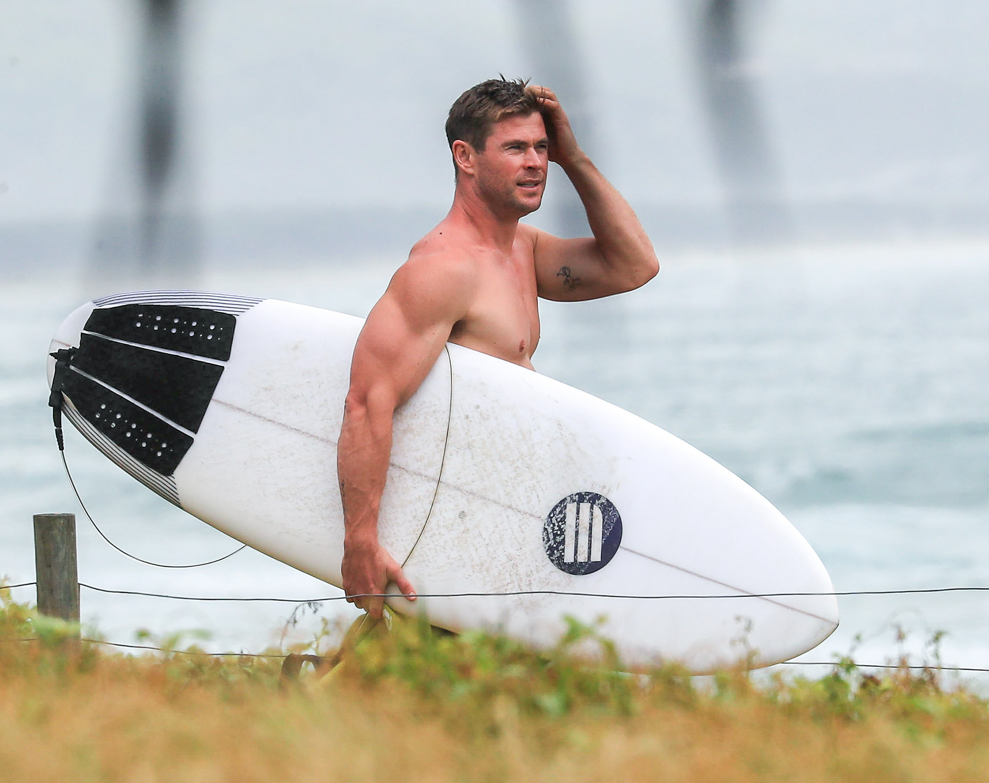 EXCLUSIVE: *NO MAIL ONLINE* Chris Hemsworth enjoys a morning surf during his festive break in Byron Bay, Australia