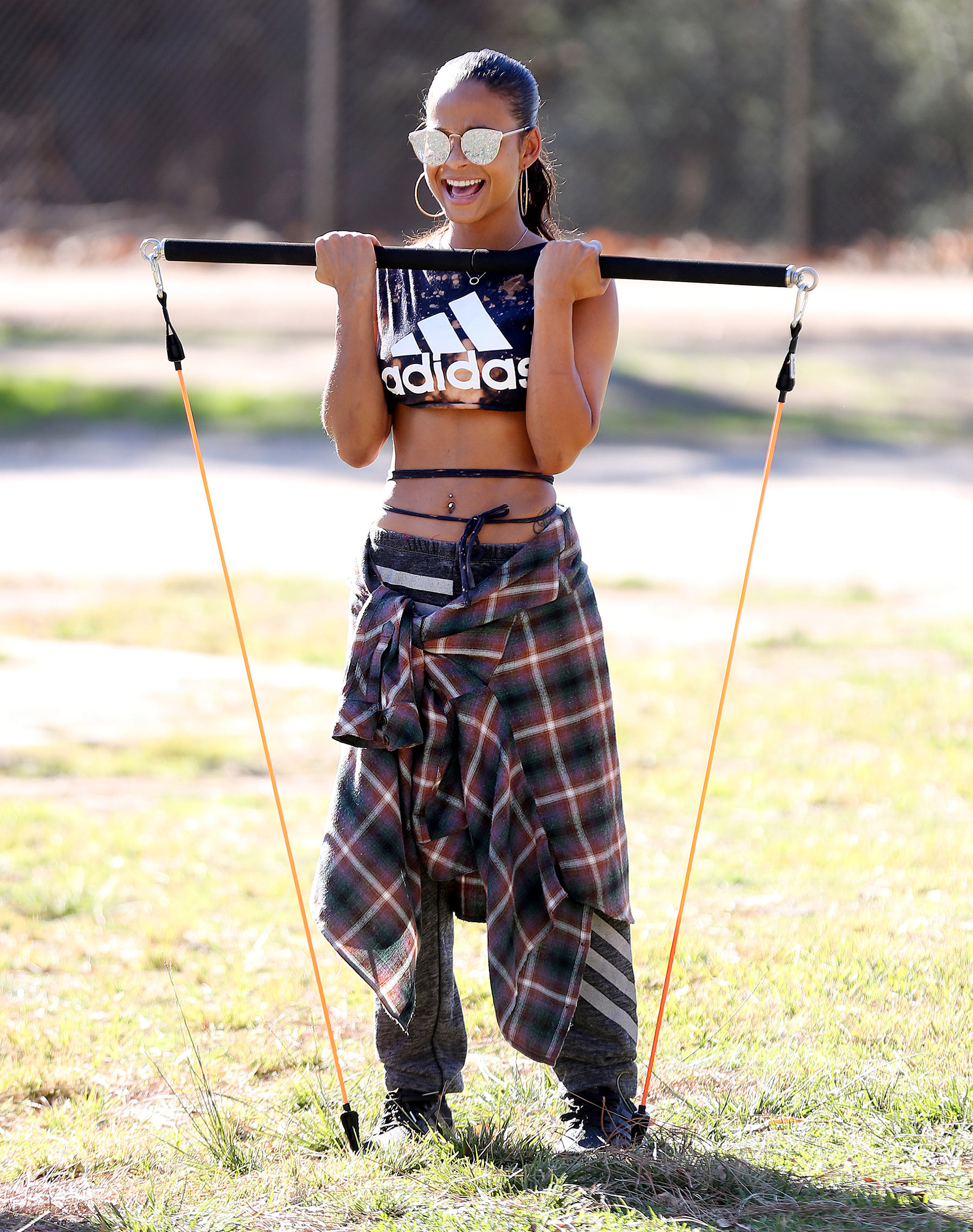 EXCLUSIVE: Christina Milian shows off her stunning figure and washboard abs in some skimpy adidas work out gear as she puts herself through her paces during a park work out in the unusually warm Los Angeles,CA weather.