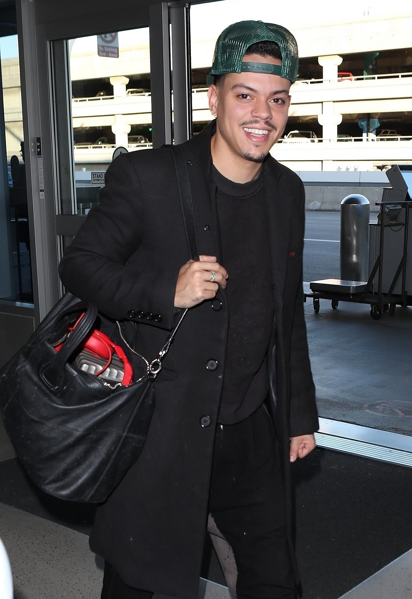 *EXCLUSIVE* Evan Ross flashes a peace sign at LAX