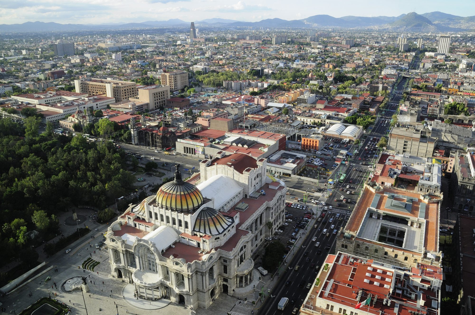 Mexico, Federal District, Mexico City, View across the city from Torre Latinoamericana with Palacio Bellas Artes in foreground